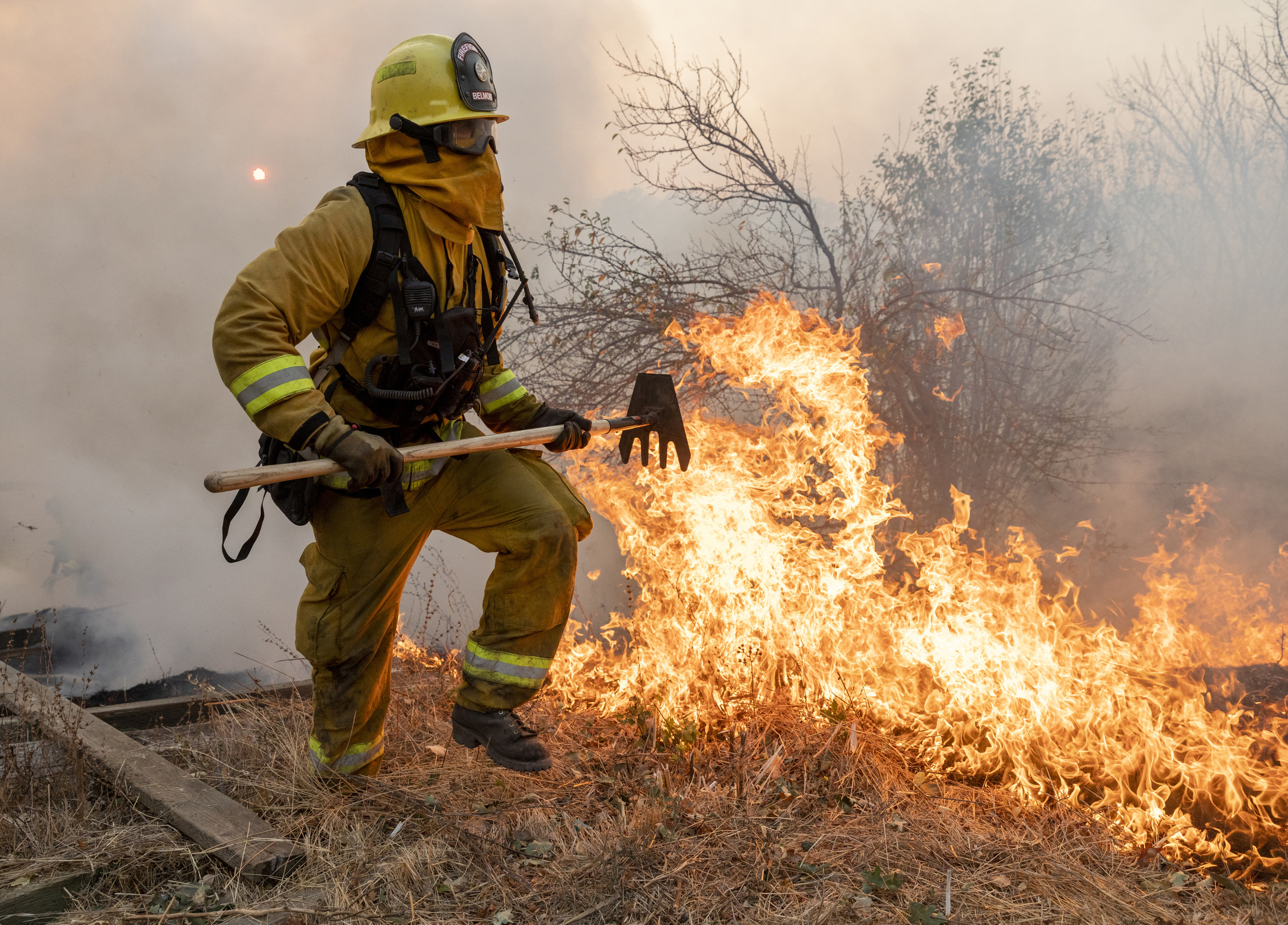 A firefighter from San Matteo helps fight the Kincade Fire in Sonoma County, Calif., on Sunday, Oct. 27, 2019. (AP Photo/Ethan Swope)