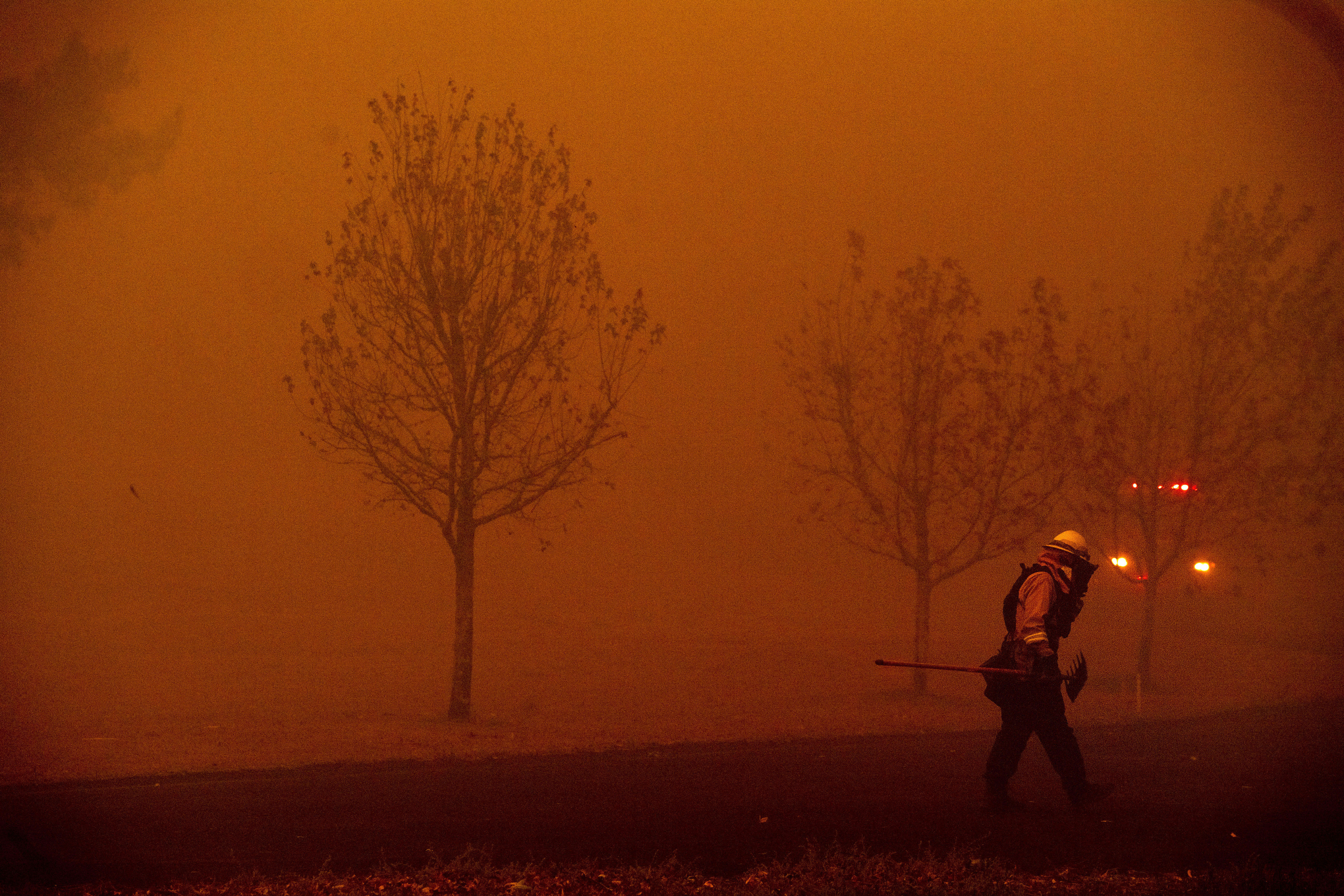 A firefighter battles a wildfire called the Kincade Fire in Healdsburg, Calif., Sunday, Oct. 27, 2019. With ferocious winds driving multiple wildfires through bone-dry vegetation and nearly 200,000 people ordered to leave their homes, California's governor declared a statewide emergency Sunday. (AP Photo/Noah Berger)