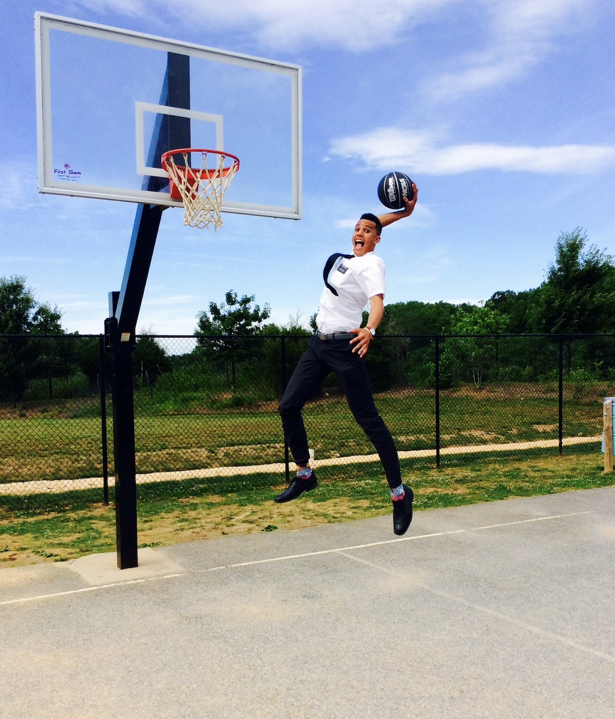 Brendan Bailey goes up for a dunk while dressed in missionary attire. Bailey, the son of former NBA player Thurl Bailey, served his mission in Washington D.C. from 2016 to 2018.