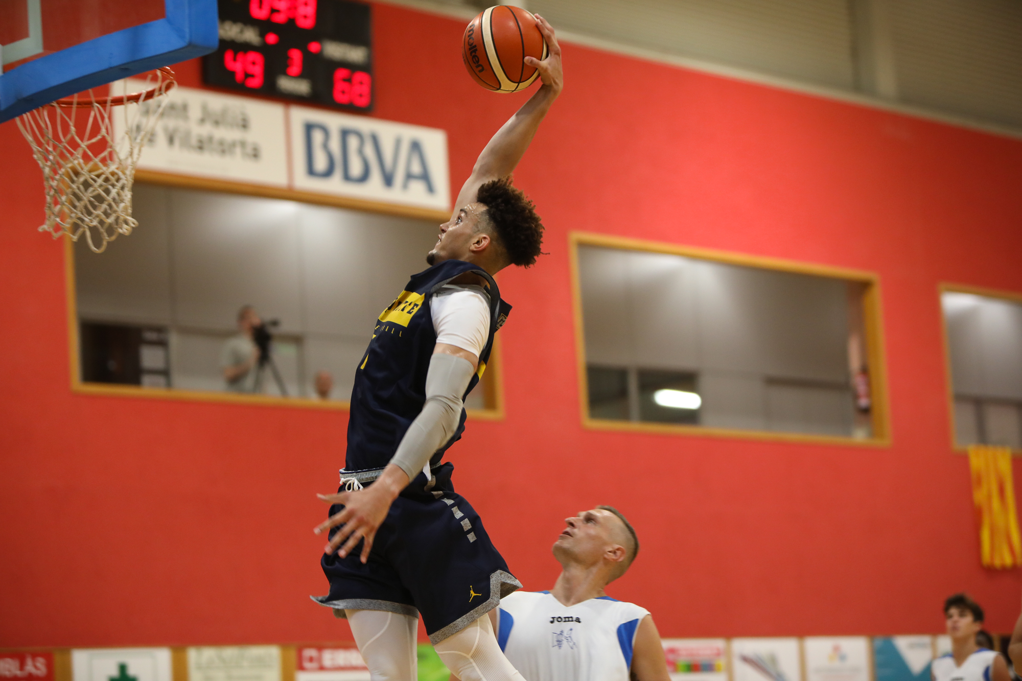 Marquette forward Brendan Bailey goes up for a dunk during a game in Spain this past summer.