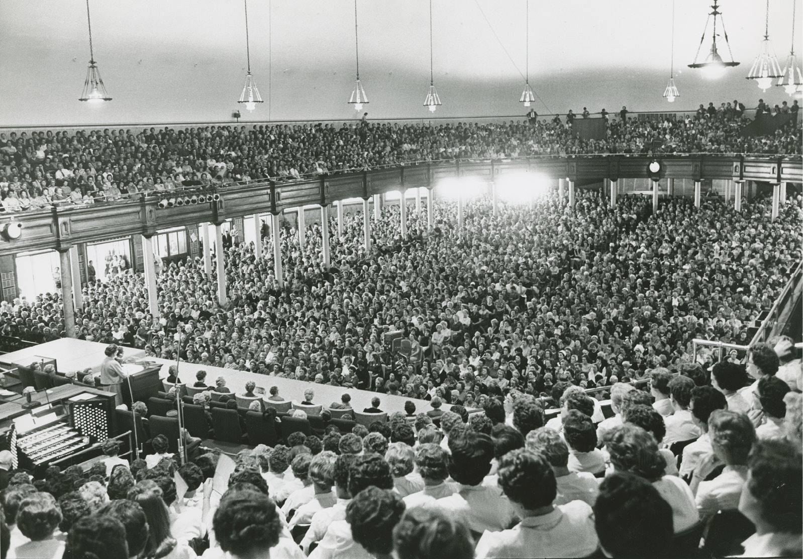 Relief Society General Conference in 1962. The first Relief Society general conference was held in 1889. This photograph of the Salt Lake Tabernacle shows a large crowd at one of the sessions of the October 1962 conference, at which Sister Louise W. Madsen spoke. Photograph by Ross Welser.