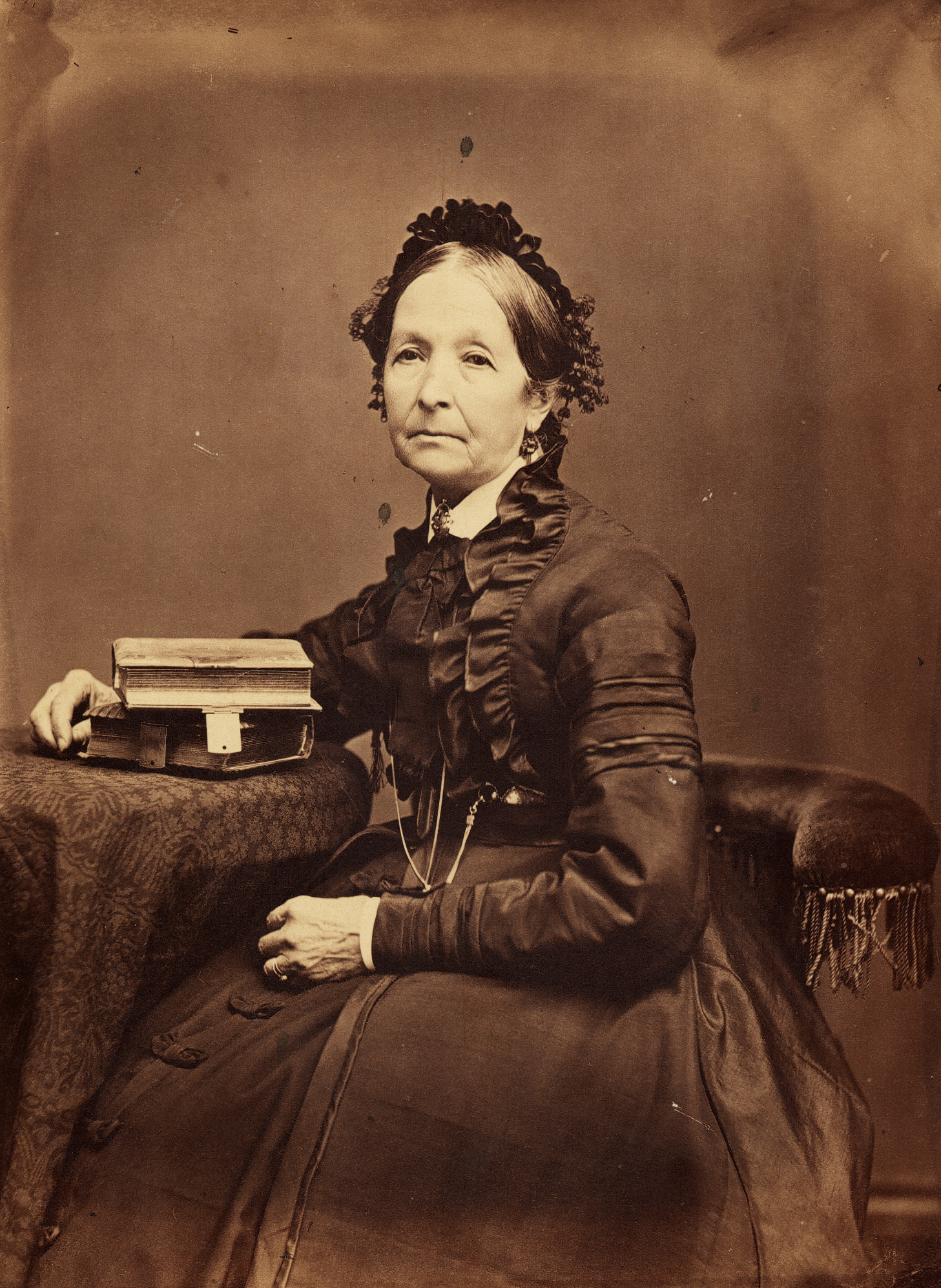 Eliza R. Snow, circa 1875. Snow was a poet, a world traveler, and a renowned leader of Latter-day Saint women. She effectively linked the Nauvoo Relief Society to the resurgence of the organization in the Utah Territory by preserving the Nauvoo Relief Society Minute Book and traveling throughout Mormon settlements to help organize women and encourage them to speak. Photograph by Charles Carter.