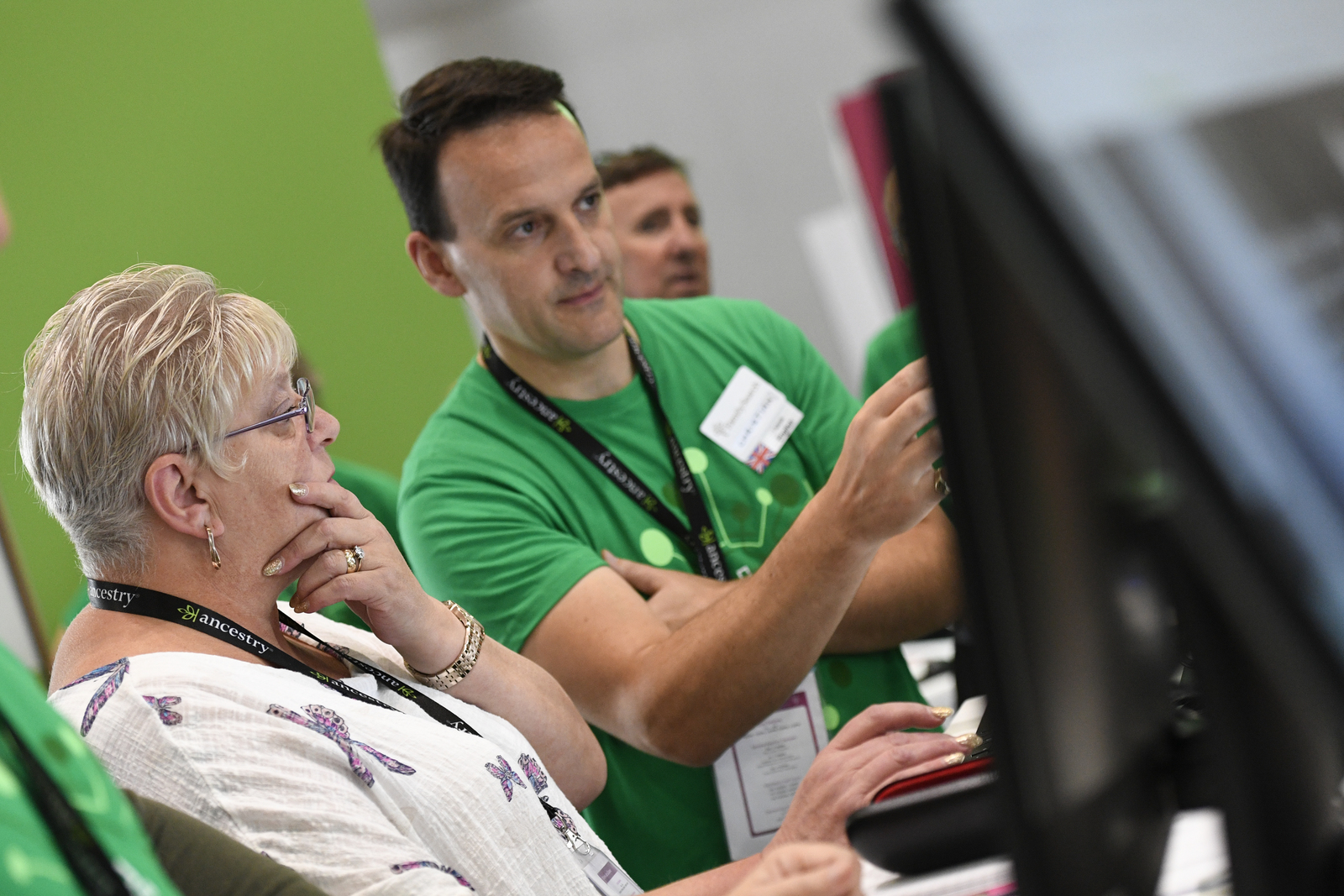 FamilySearch assistants help attendees to RootsTech London in the FamilySearch booth in the London ExCel exhibition hall on Thursday, Oct. 24. 2019.