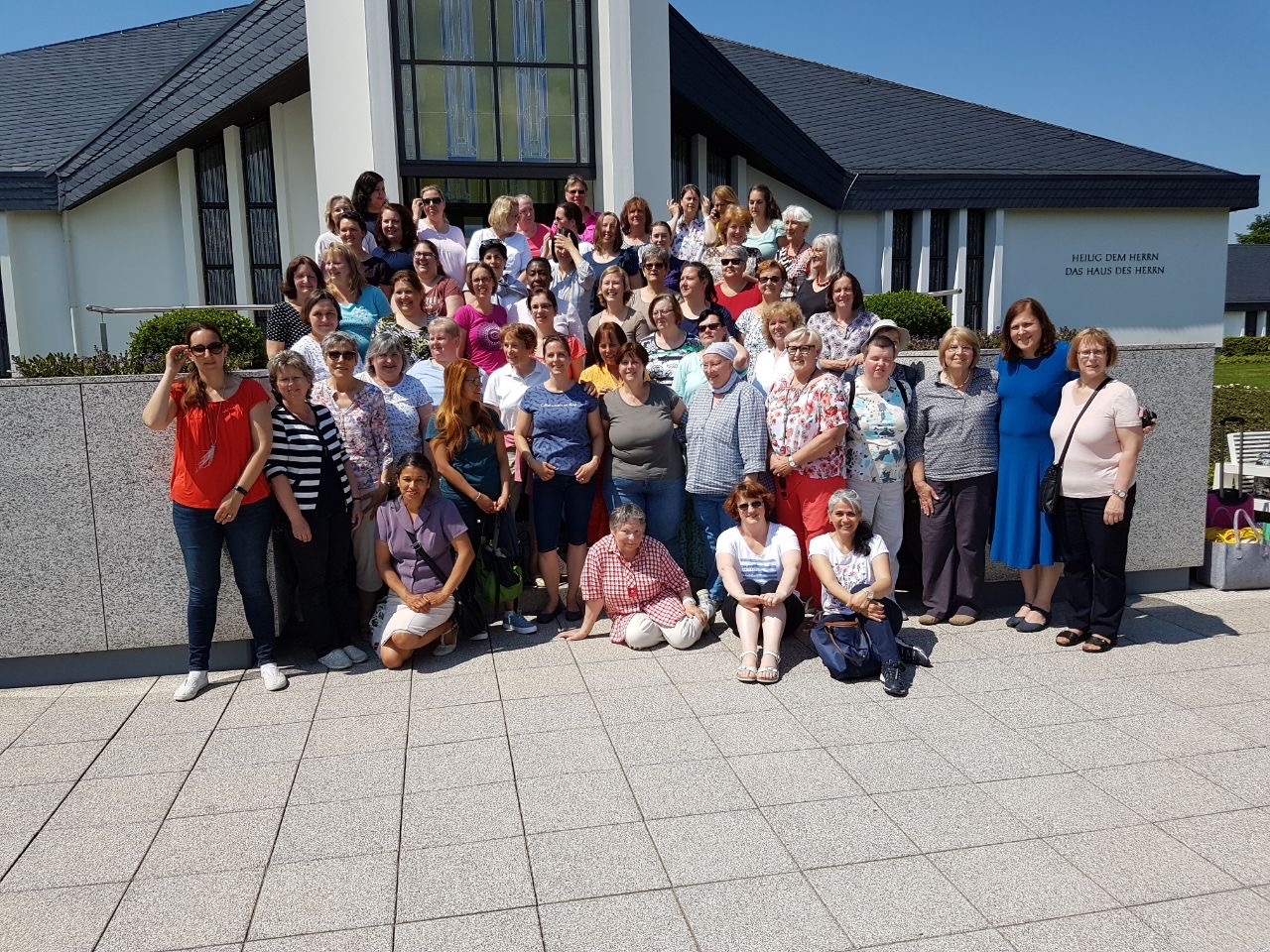 Sisters of the Friedrichsdorf Germany Stake gather outside the Freiberg Germany Temple during their May 2018 temple trip.