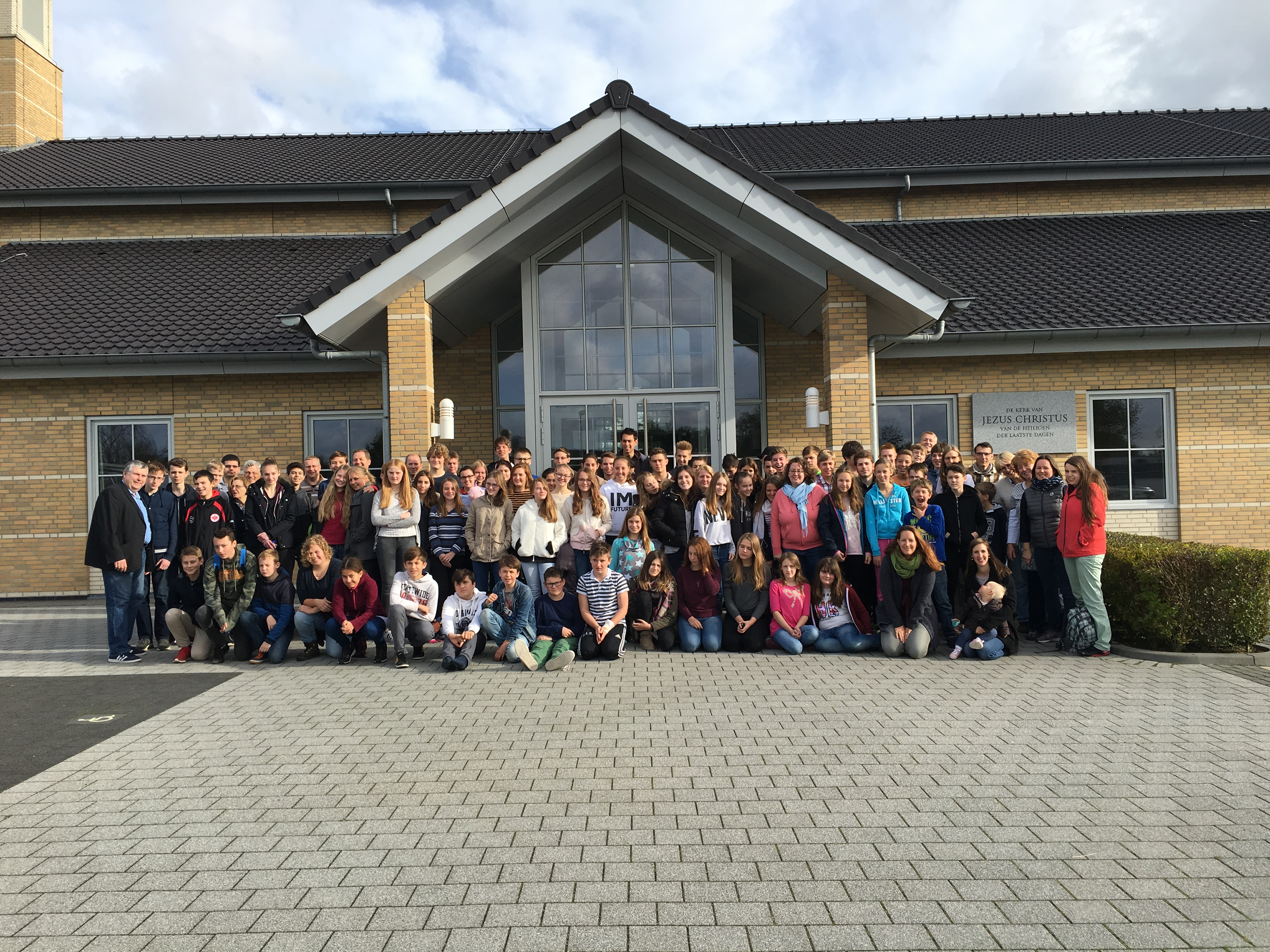 During their October 2017 temple trip to The Hague Netherlands Temple, youth from the Friedrichsdorf Germany Stake pause for group photo outside a chapel near the temple.