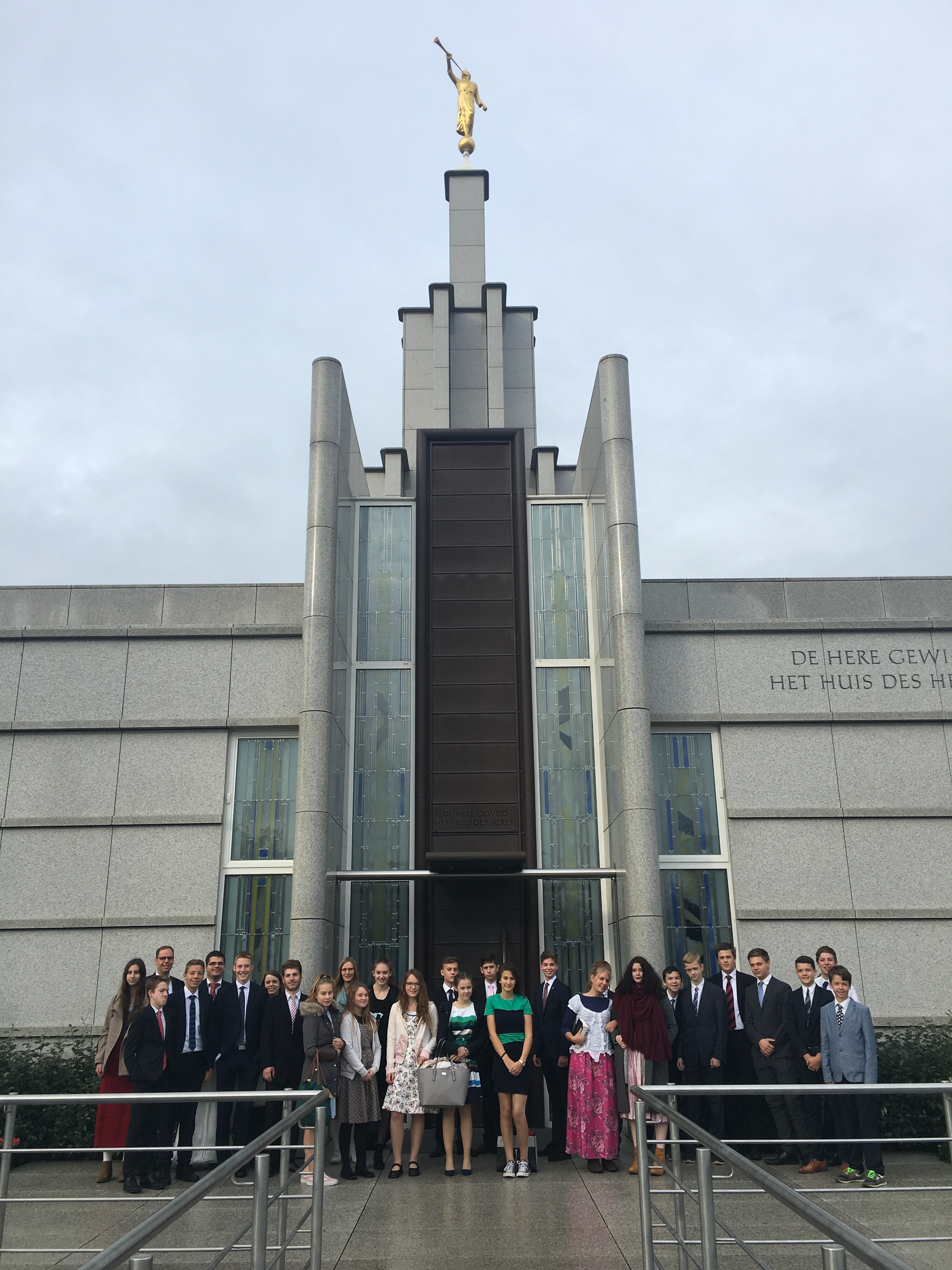 During their October 2017 temple trip to The Hague Netherlands Temple, youth from the Friedrichsdorf Germany Stake pause for group photo outside the temple.