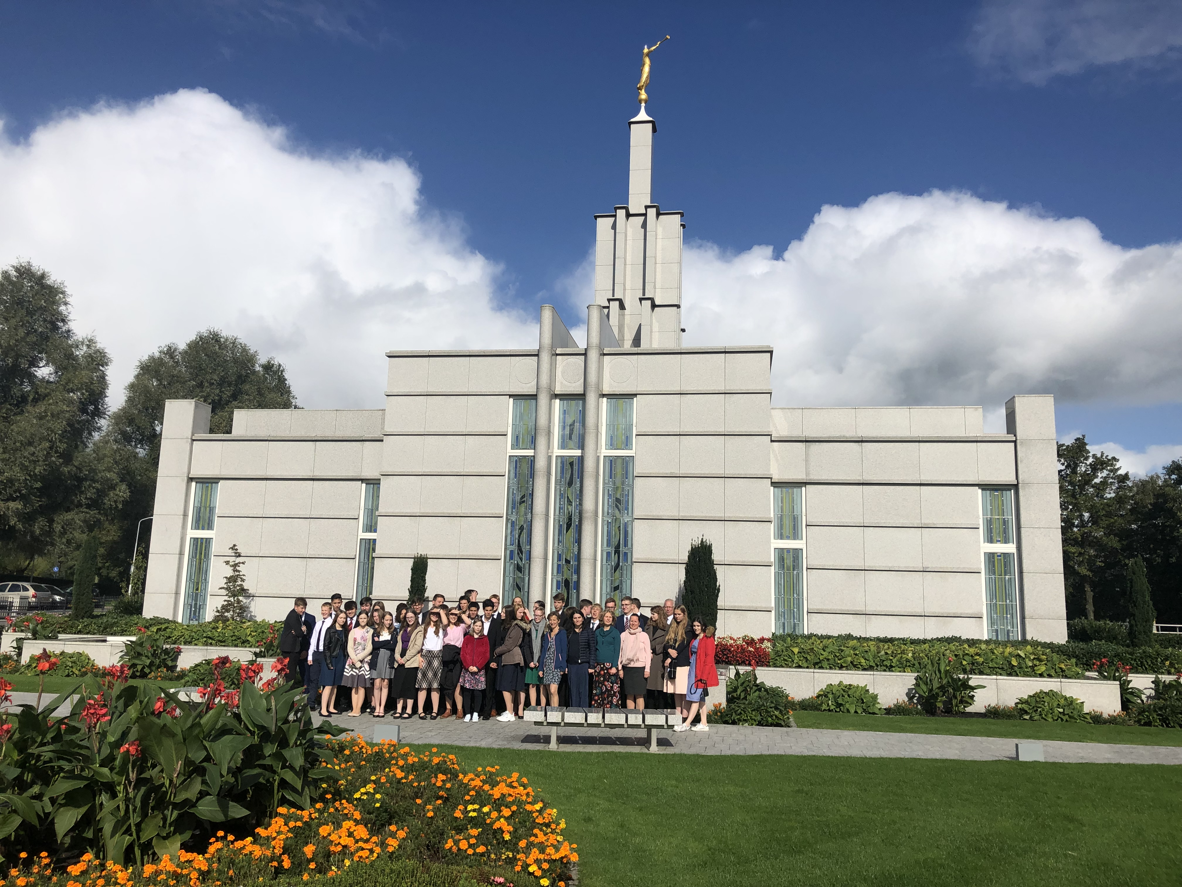 Youth of the Friedrichsdorf Germany Stake gather outside The Hague Netherlands Temple during the stake's October 2019 temple trip.