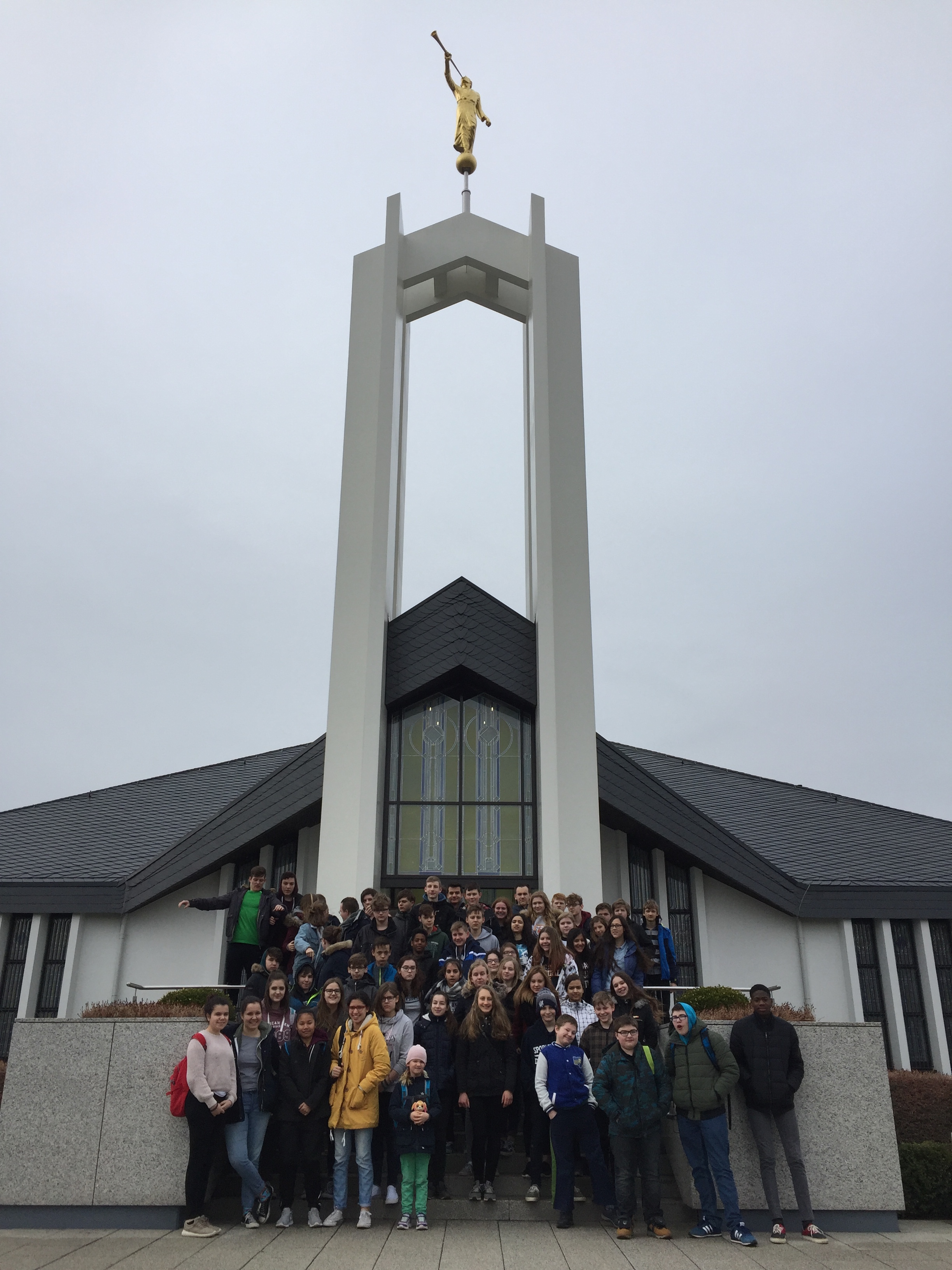 Youth of the Frankfurt Germany Stake pose for a photo outside the Freiberg Germany Temple during a stake temple trip.