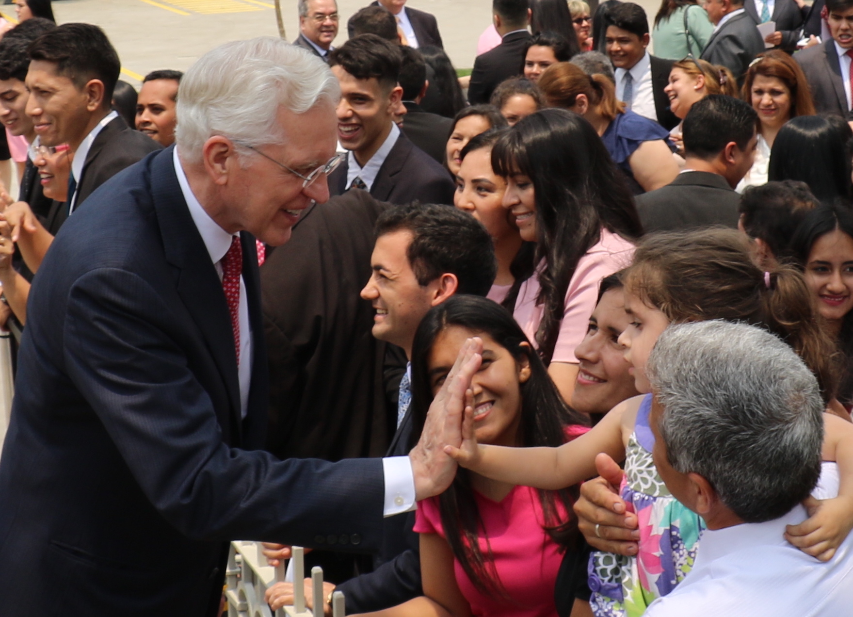 Elder D. Todd Christofferson high-fives a little girl following the Nov. 3, 2019, rededication of the Asuncion Paraguay Temple.