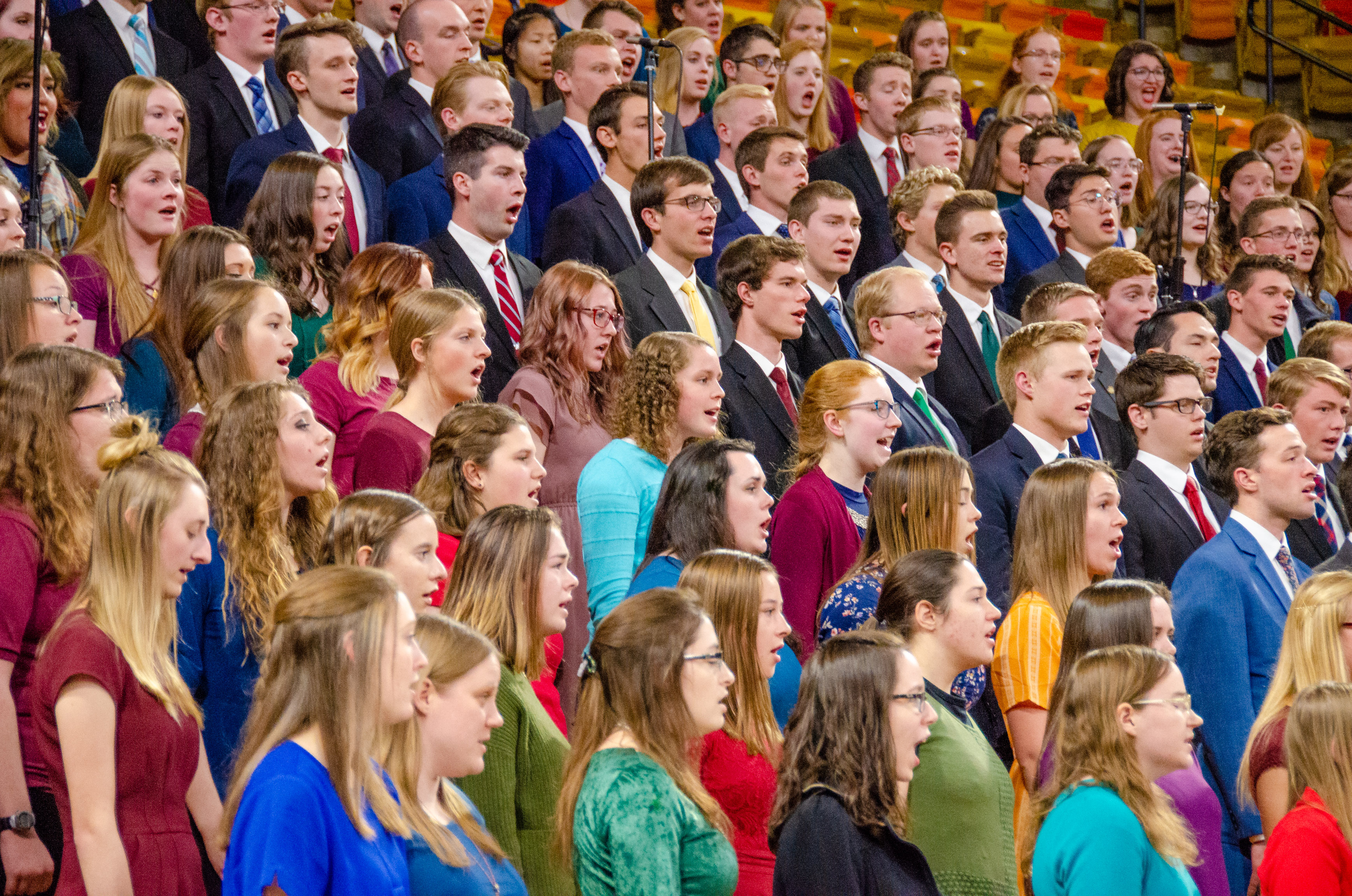 A combined institute choir sings during a devotional with Sister Sharon Eubank at the Dee Glen Smith Spectrum at Utah State University in Logan, Utah, on Sunday, Nov. 3, 2019.