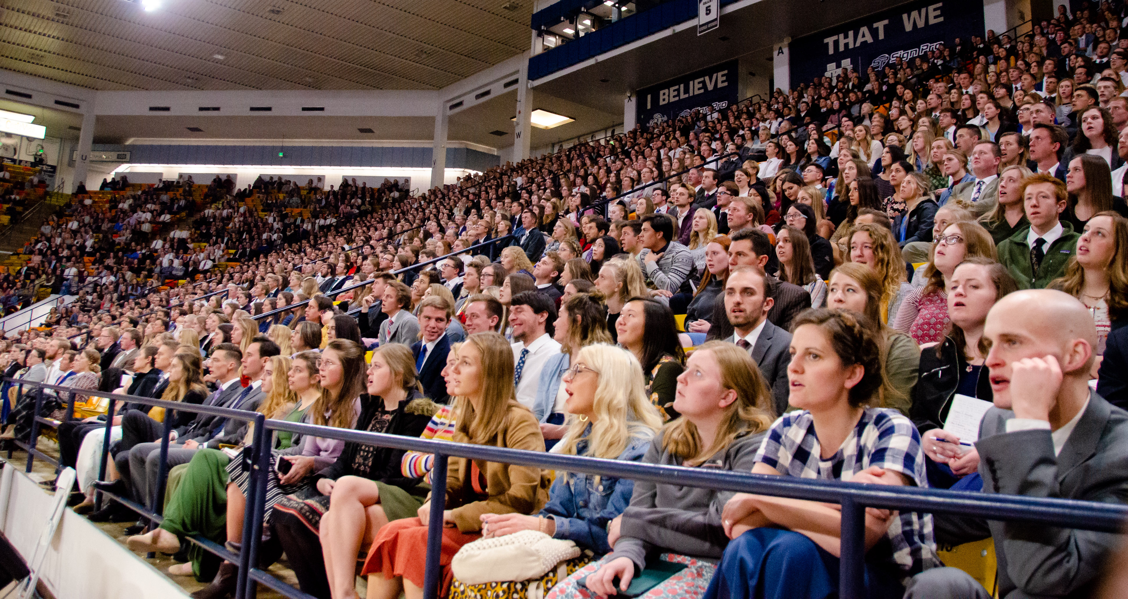 Attendees at the Dee Glen Smith Spectrum at Utah State University sing a hymn during a devotional with Sister Sharon Eubank on Sunday, Nov. 3, 2019, in Logan, Utah.