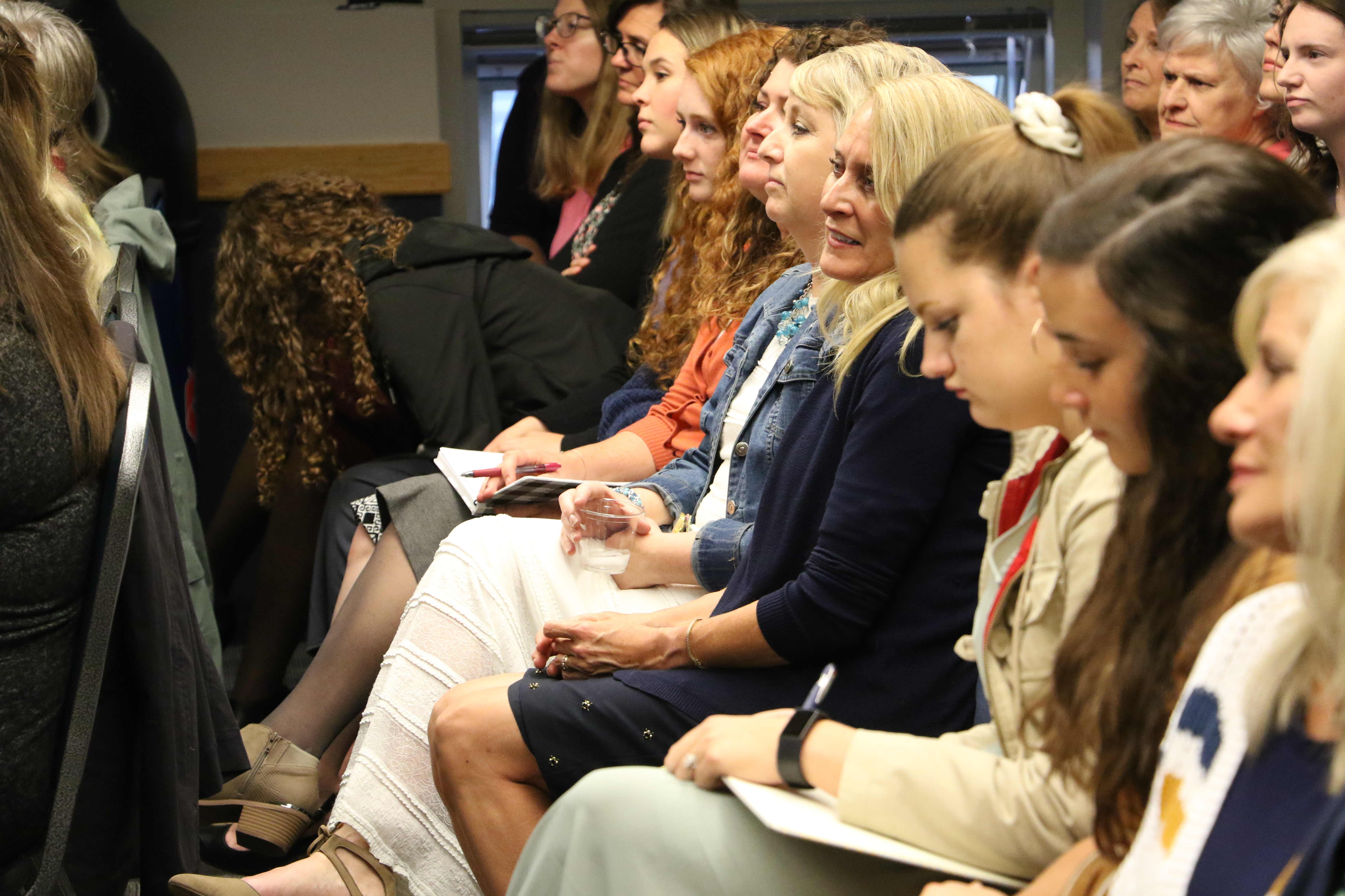 A group of women, representing nine stakes of young single adult and young married wards in the Logan, Utah area, participate in a Q&A session with Sister Sharon Eubank prior to a devotional at the Dee Glen Smith Spectrum at Utah State University in Logan, Utah, on Sunday, Nov. 3, 2019.