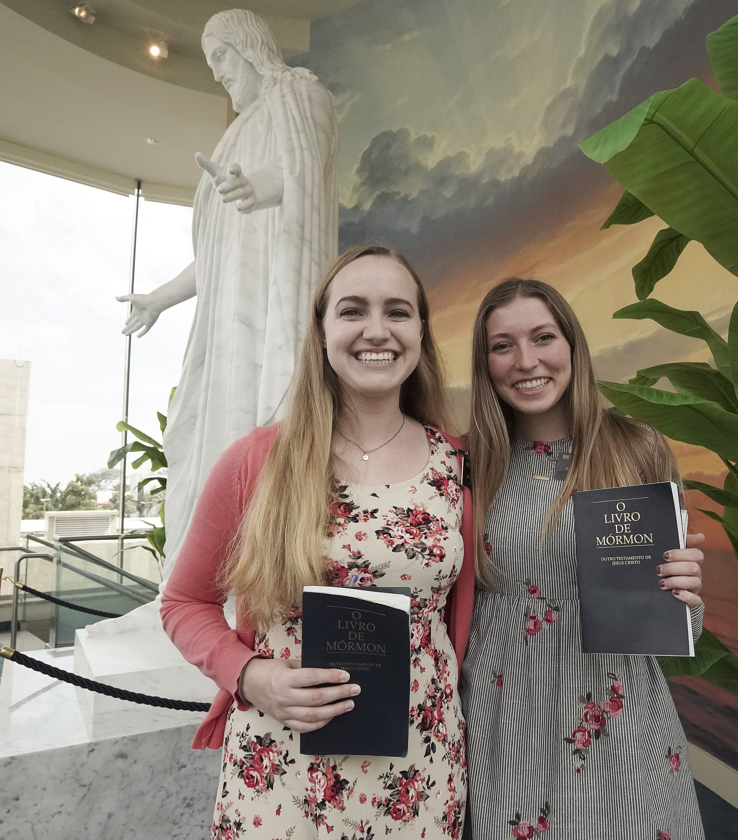 Sister Emma Loftus and Sister Brooke Williams hold their copies of the Book of Mormon in the Sao Paulo Brazil Temple visitors' center in Sao Paulo, Brazil, on Aug. 31, 2019.