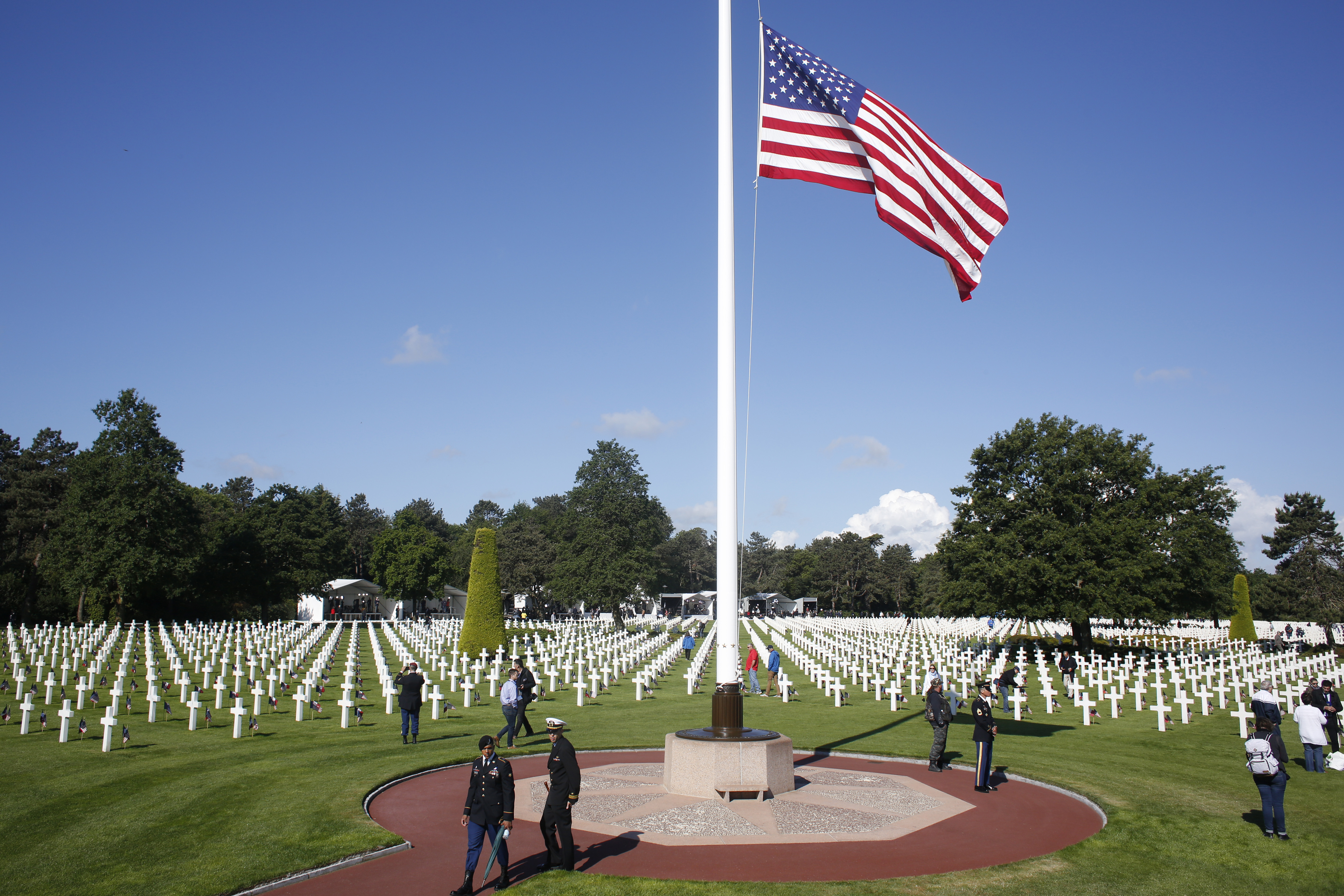 An American flag flaps in the wind prior to a ceremony to mark the 75th anniversary of D-Day at the Normandy American Cemetery in Colleville-sur-Mer, Normandy, France, Thursday, June 6, 2019. (Thibault Camus, Associated Press)