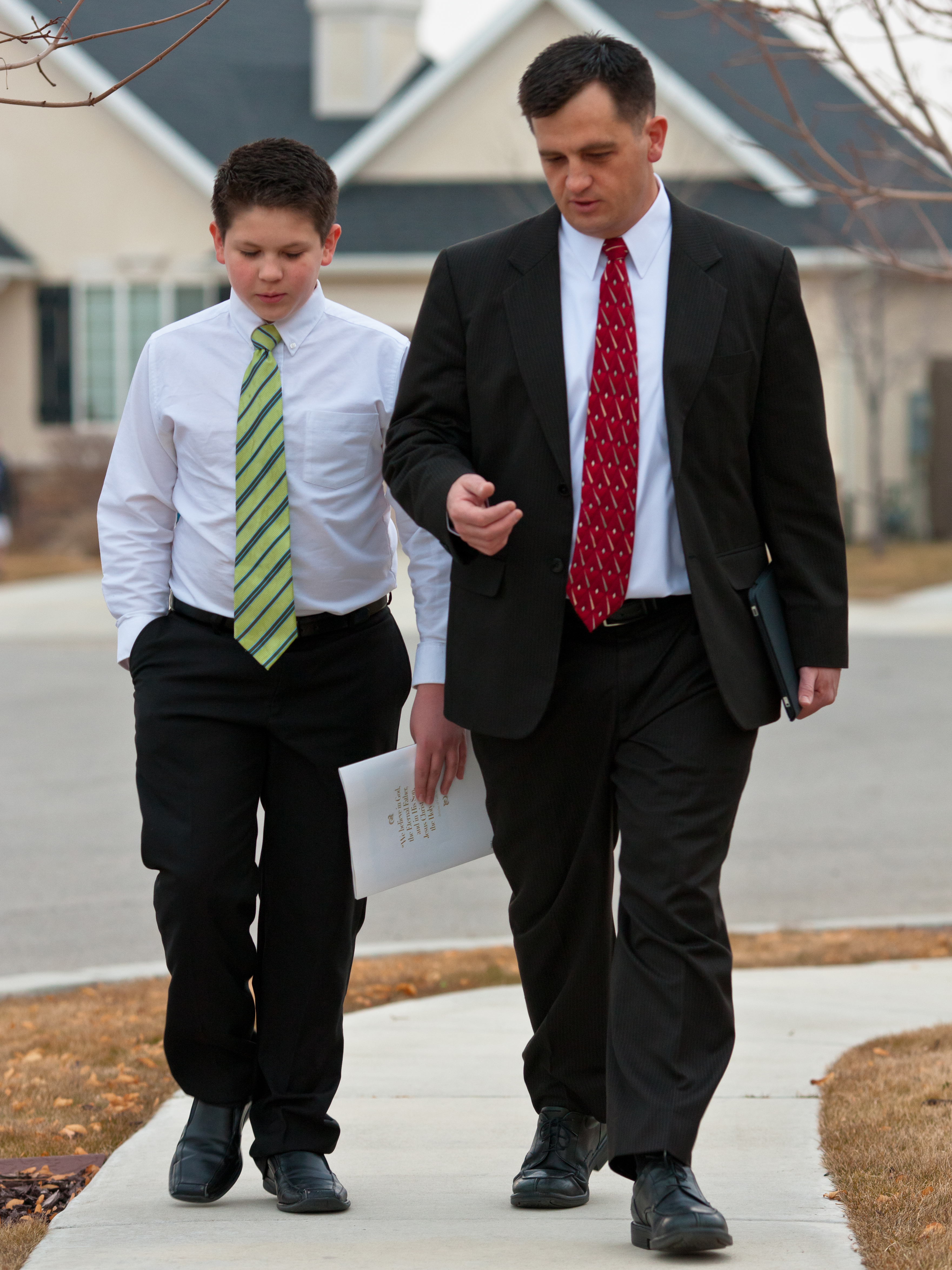 The bishop talks and walks with a young man. As President Russell M. Nelson emphasized in the October general conference, the primary responsibility of a bishop is to care for the youth.
