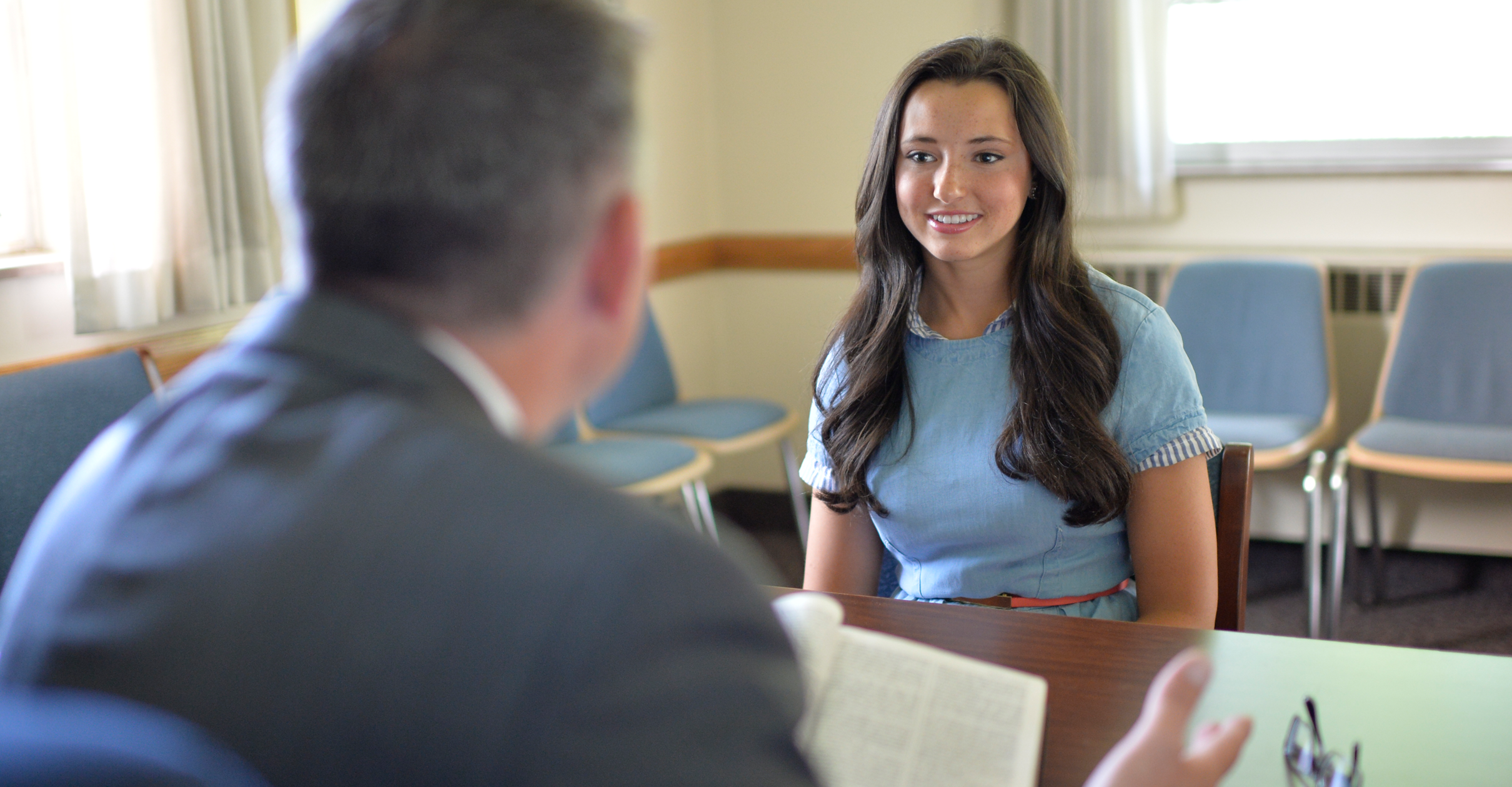 The bishop meets with a young woman. As President Russell M. Nelson emphasized in the October general conference, the primary responsibility of a bishop is to care for the youth.