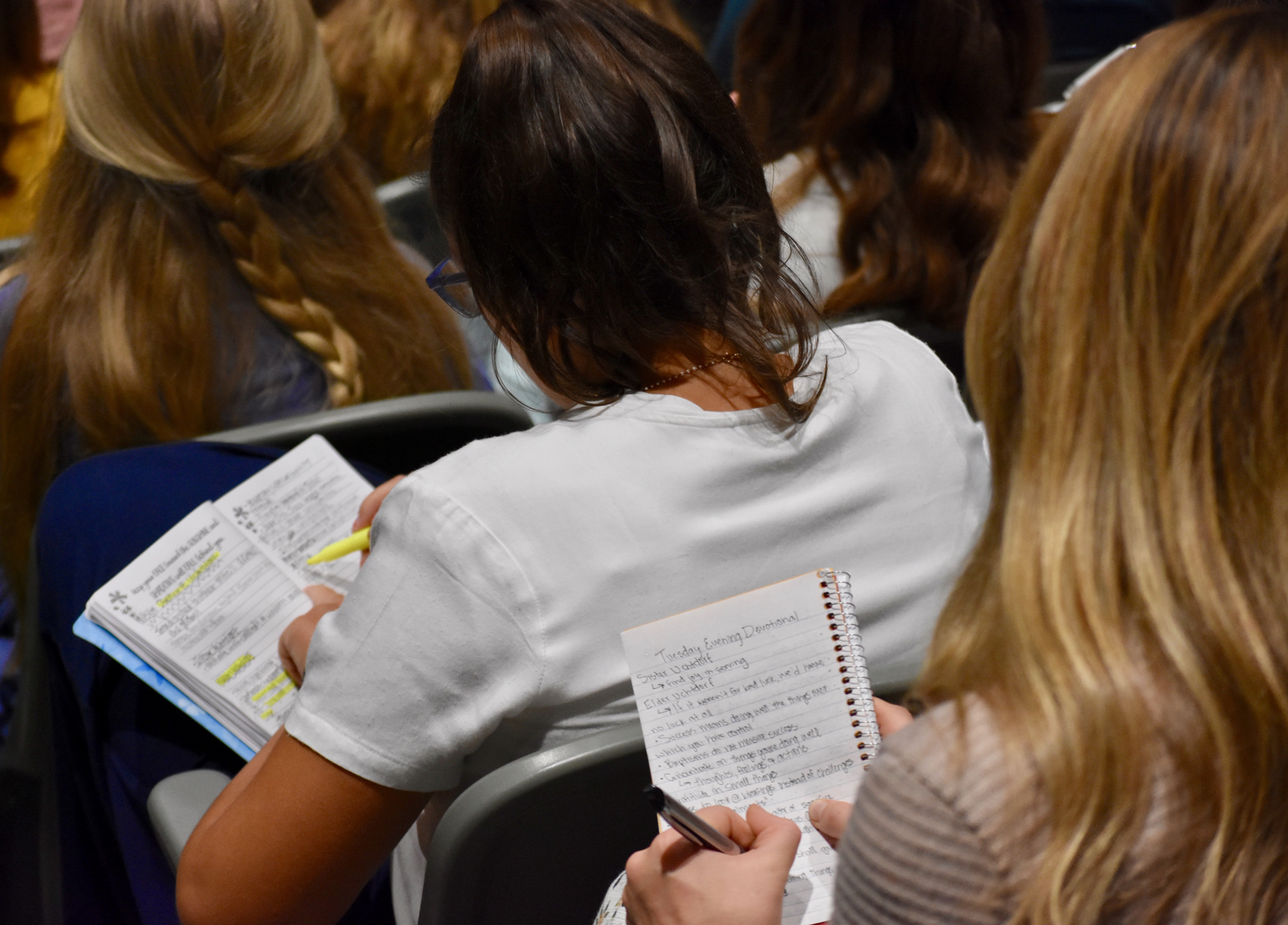 Sister missionaries take notes during a Nov. 5, 2019, devotional with Elder Dieter F. Uchtdorf at the Provo Missionary Training Center.