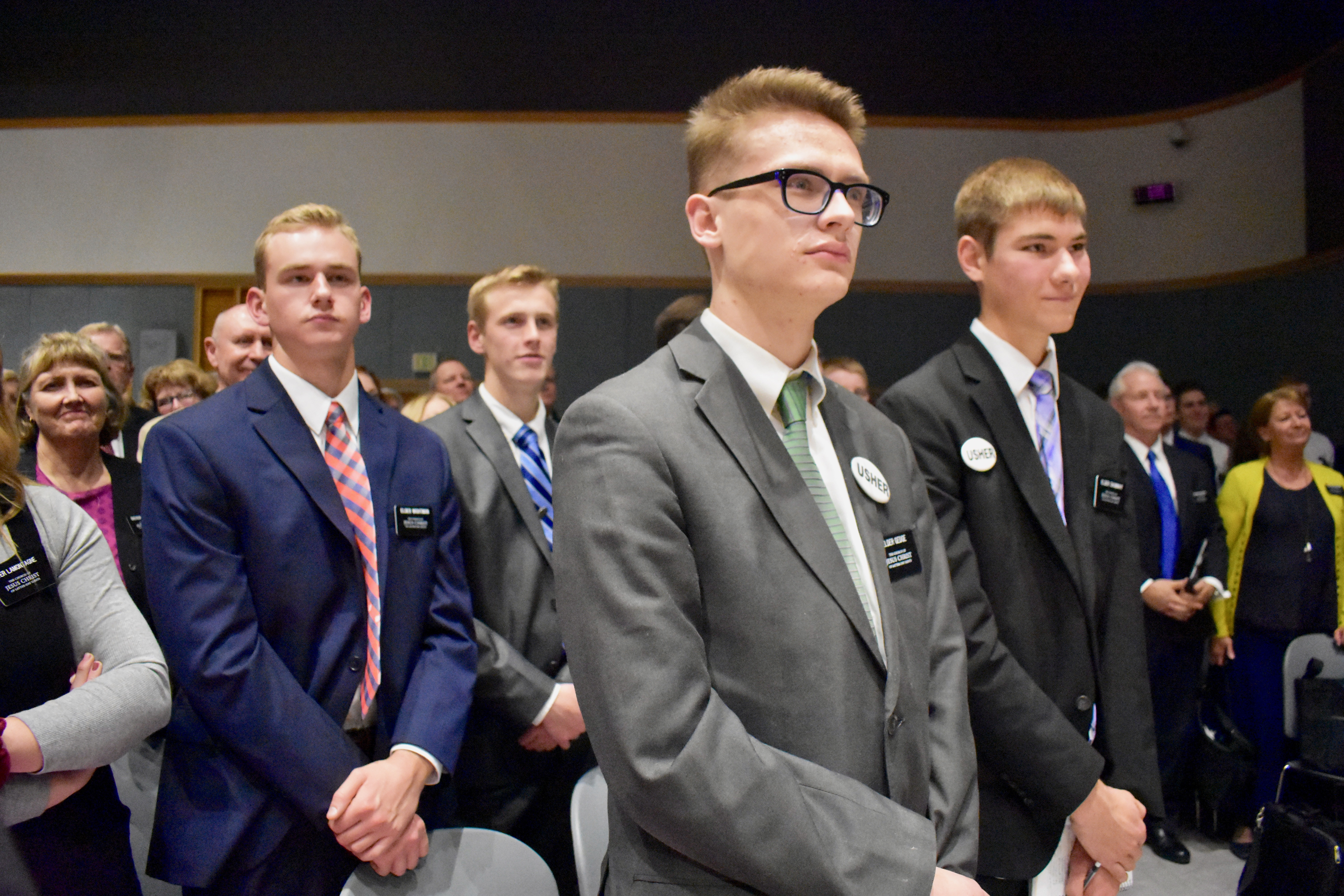 Missionaries acknowledge Elder Dieter F. Uchtdorf by standing as the apostle prepares to leave following a Nov. 5, 2019, devotional at the Provo Missionary Training Center.