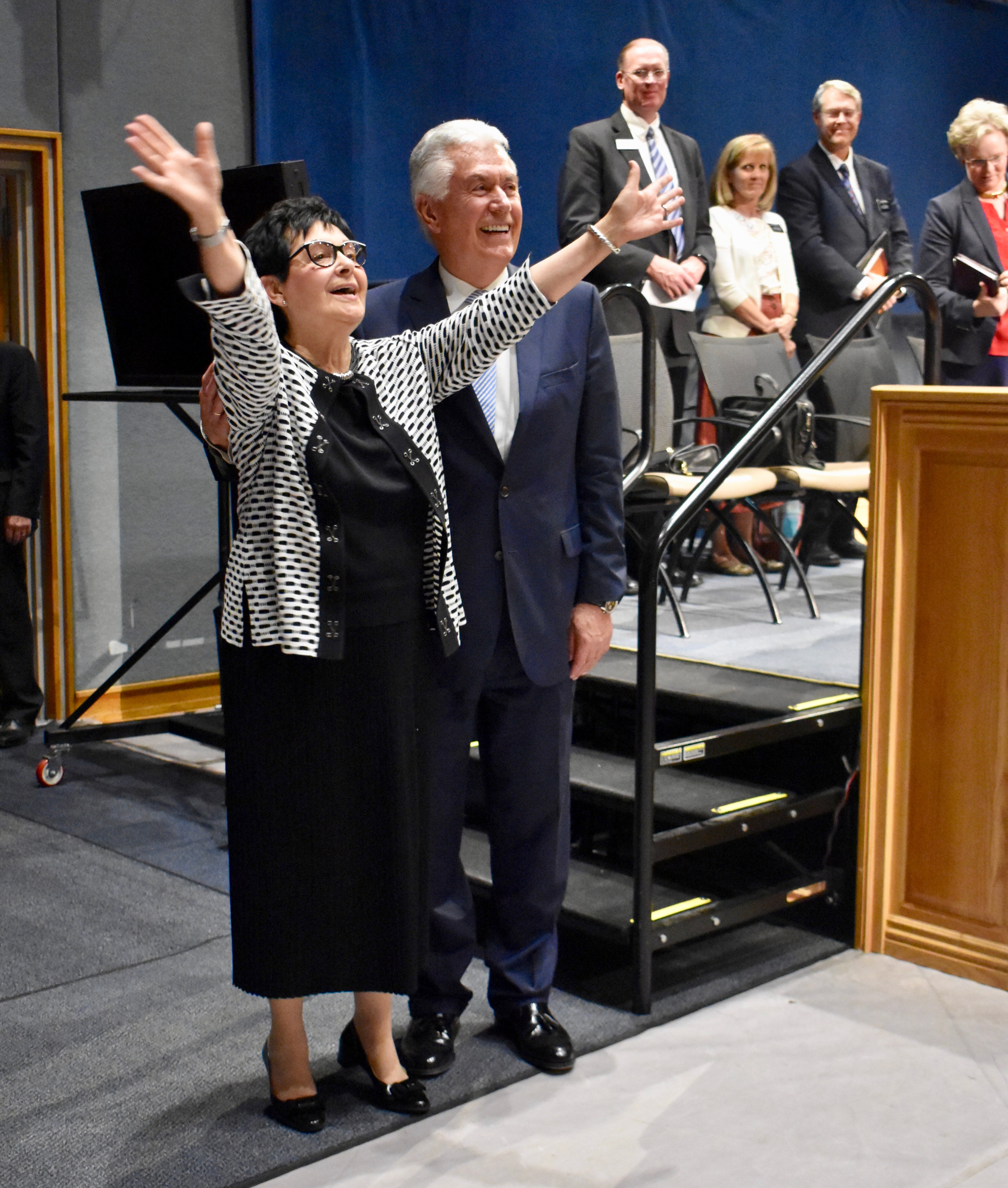 Sister Harriet Uchtdorf gestures broadly after blowing a kiss to missionaries following the Nov. 5, 2019, devotional with her husband, Elder Dieter F. Uchtdorf, at the Provo Missionary Training Center.