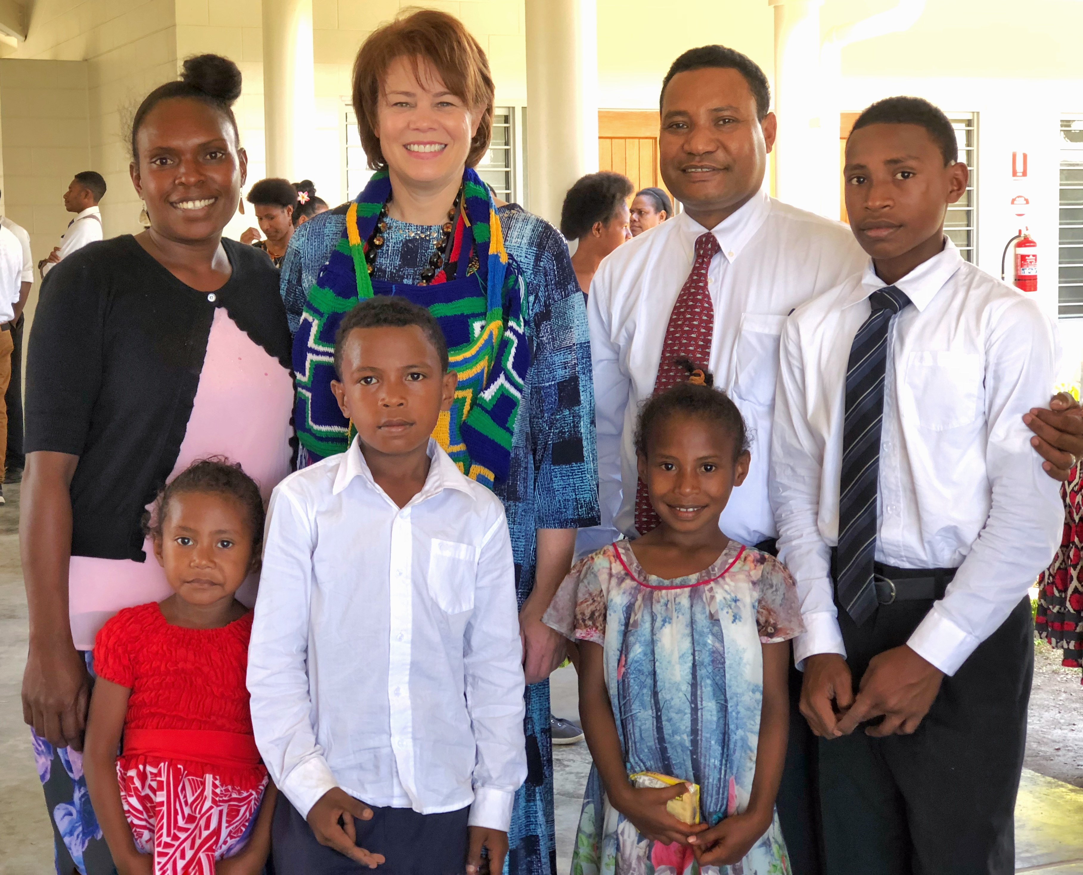 Sister Sharon Eubank poses for a photo with Church members in Papua New Guinea during a trip to the Pacific Area in October 2019.