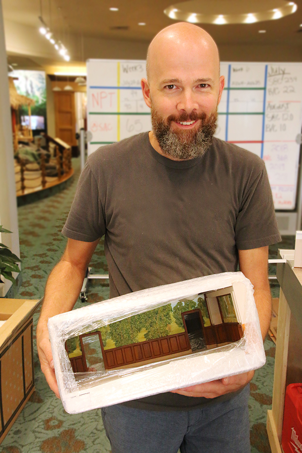 Schaffer Studios foreman Nick Stephens unpacks the garden room portion of the new Laie Hawaii Temple cut-away model.