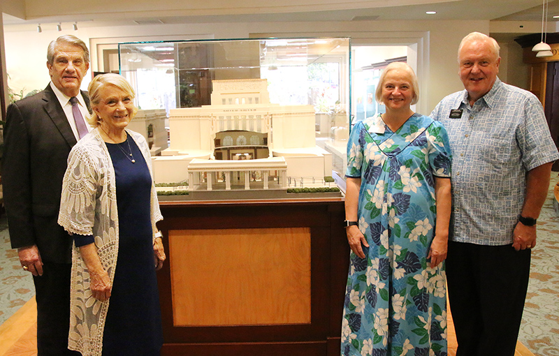 Laie Hawaii Temple President James H. Hallstrom Jr., left, and temple matron Sister Kathleen Hallstrom and the visitors' center director Elder Stephen B. Allen and his wife, Sister Nancy Allen, are among the first to experience the new cut-away model of the temple.