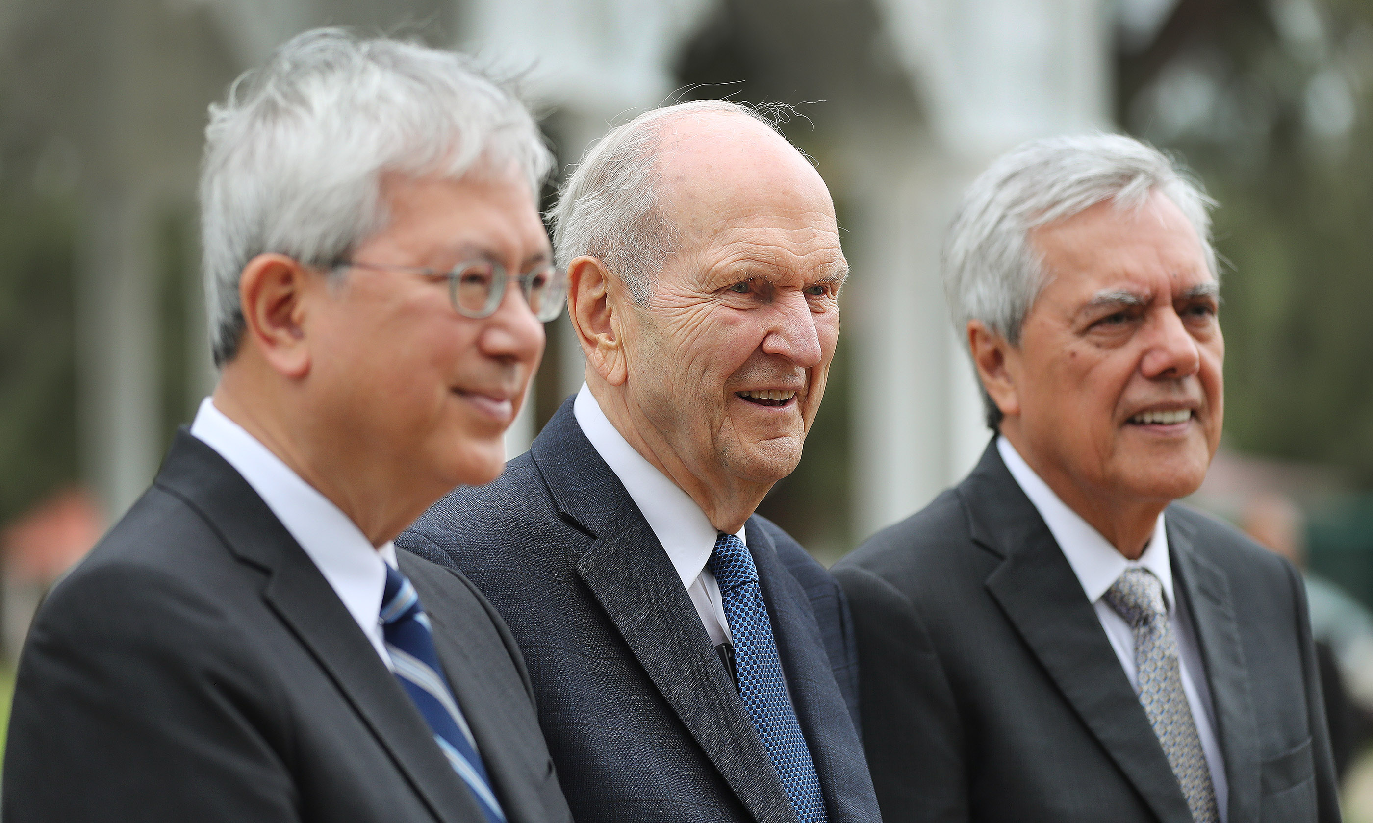 President Russell M. Nelson of The Church of Jesus Christ of Latter-day Saints, Elder Gerrit W. Gong of the Quorum of the Twelve Apostles and Elder O. Vincent Halleck speak with media after meeting with 'Aho'eitu Tupou VI, King of Tonga, at the Royal Palace in Tonga on May 23, 2019.