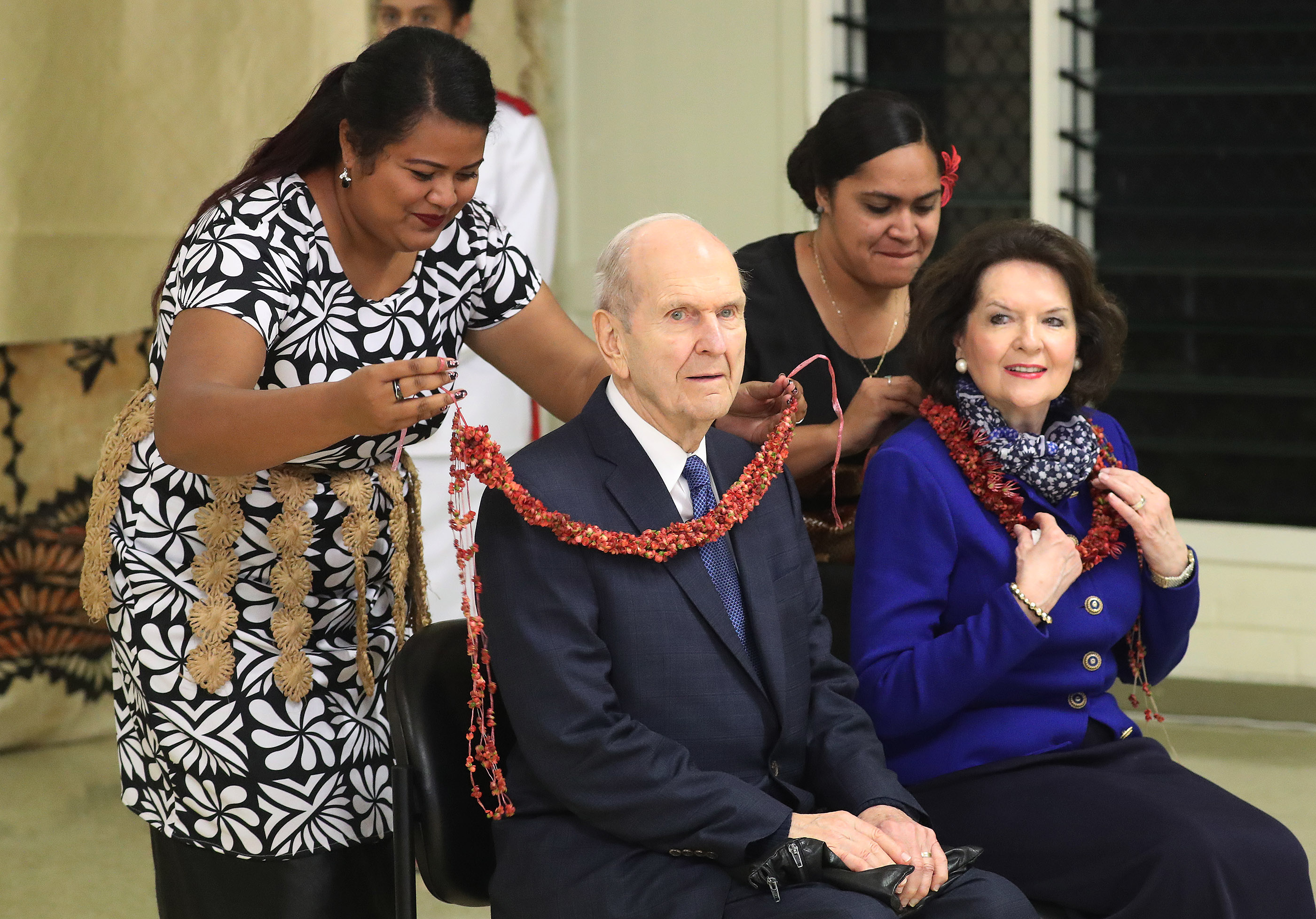 President Russell M. Nelson of The Church of Jesus Christ of Latter-day Saints and his wife, Sister Wendy Nelson, receive a lei in Tonga on May 23, 2019.