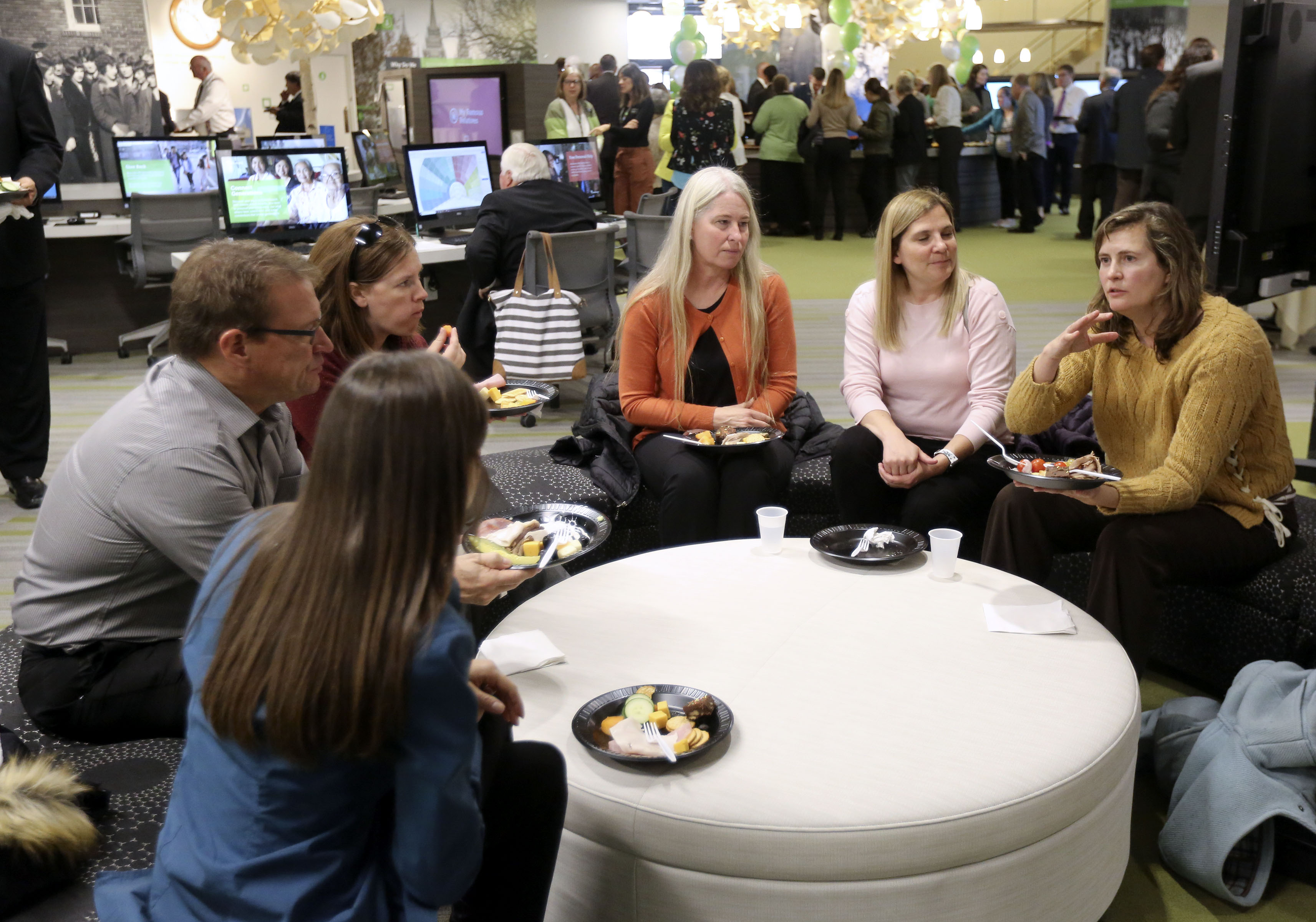 People chat and snack during the FamilySearch 125th anniversary celebration at the Family History Library in Salt Lake City on Wednesday, Nov. 13, 2019.