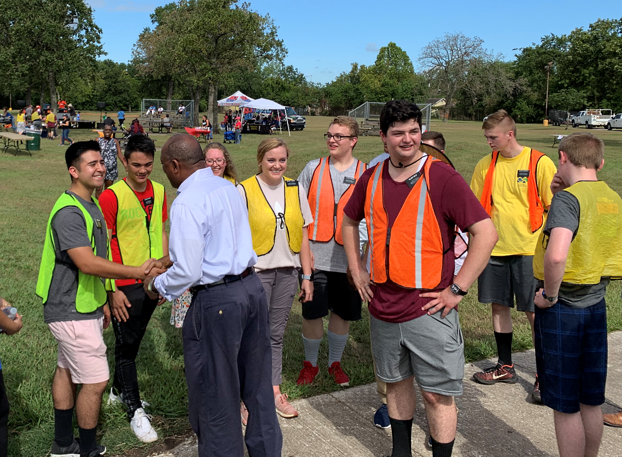 Houston Mayor Sylvester Turner greets missionaries serving in the Texas Houston Mission who were invited to help with the backpack and supply giveaway project at Kashmere Gardens.