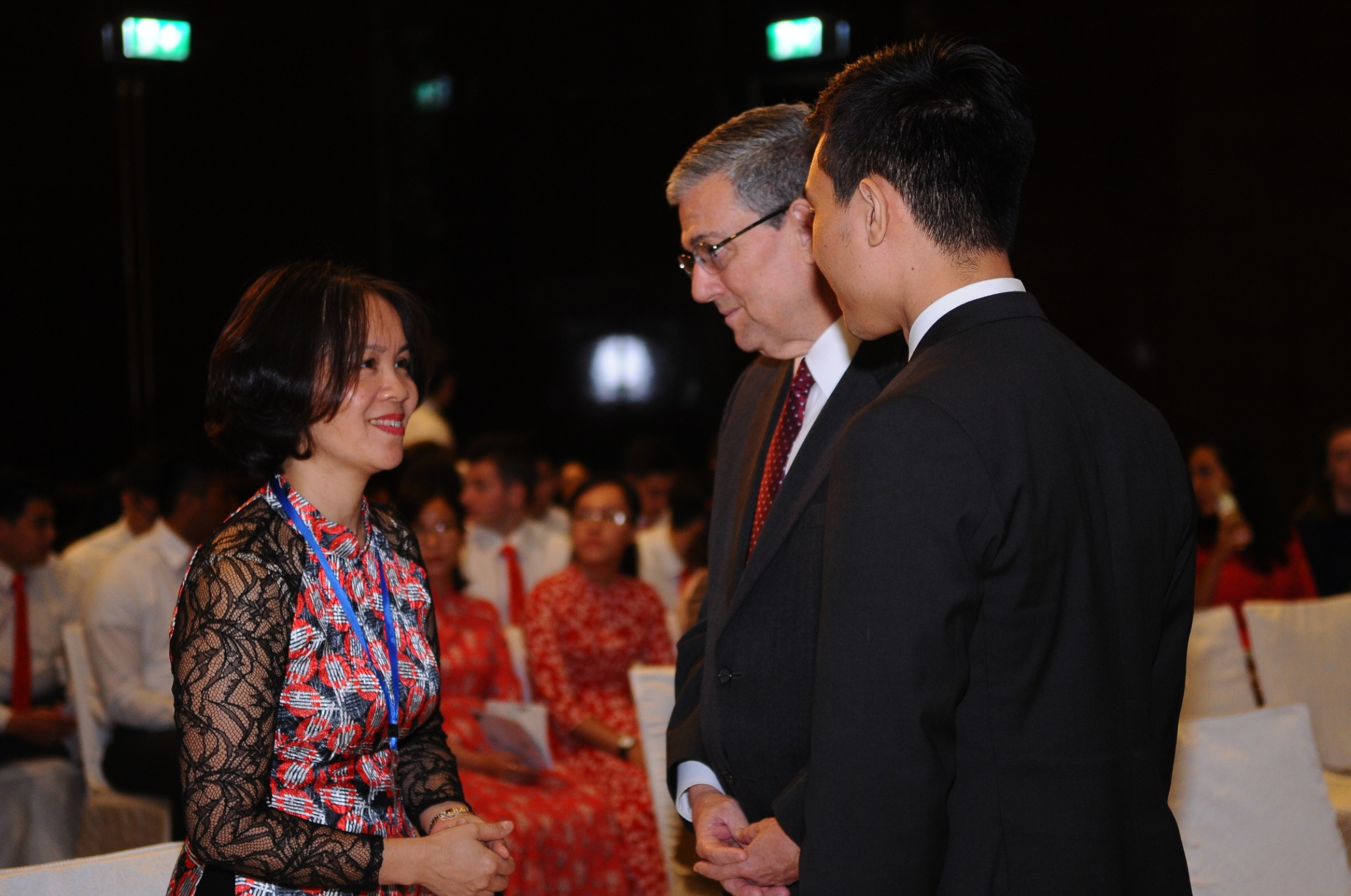 Asia Area President Elder David F. Evans and Madam Thieu Thi Huong of Vietnam CRA exchange greetings prior to the recognition ceremony in Hanoi, Vietnam, on Nov. 14, 2019.