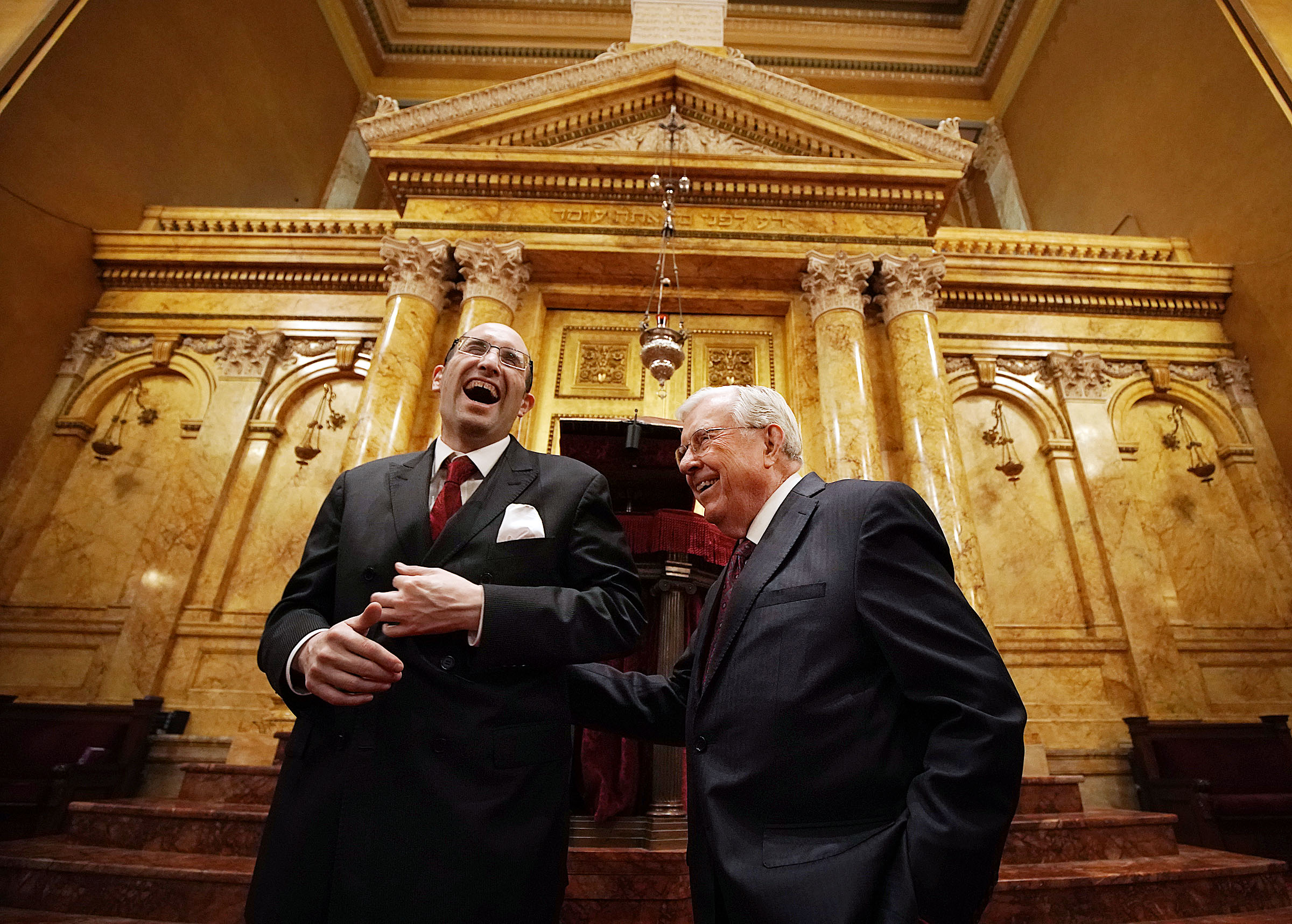 President M. Russell Ballard, right, acting president of the Quorum of the Twelve Apostles of The Church of Jesus Christ of Latter-day Saints, shares a joke with Rabbi Meir Y. Soloveichik as they tour the Spanish and Portuguese Synagogue of the Congregation Shearith Israel in New York City on Friday, Nov. 15, 2019.