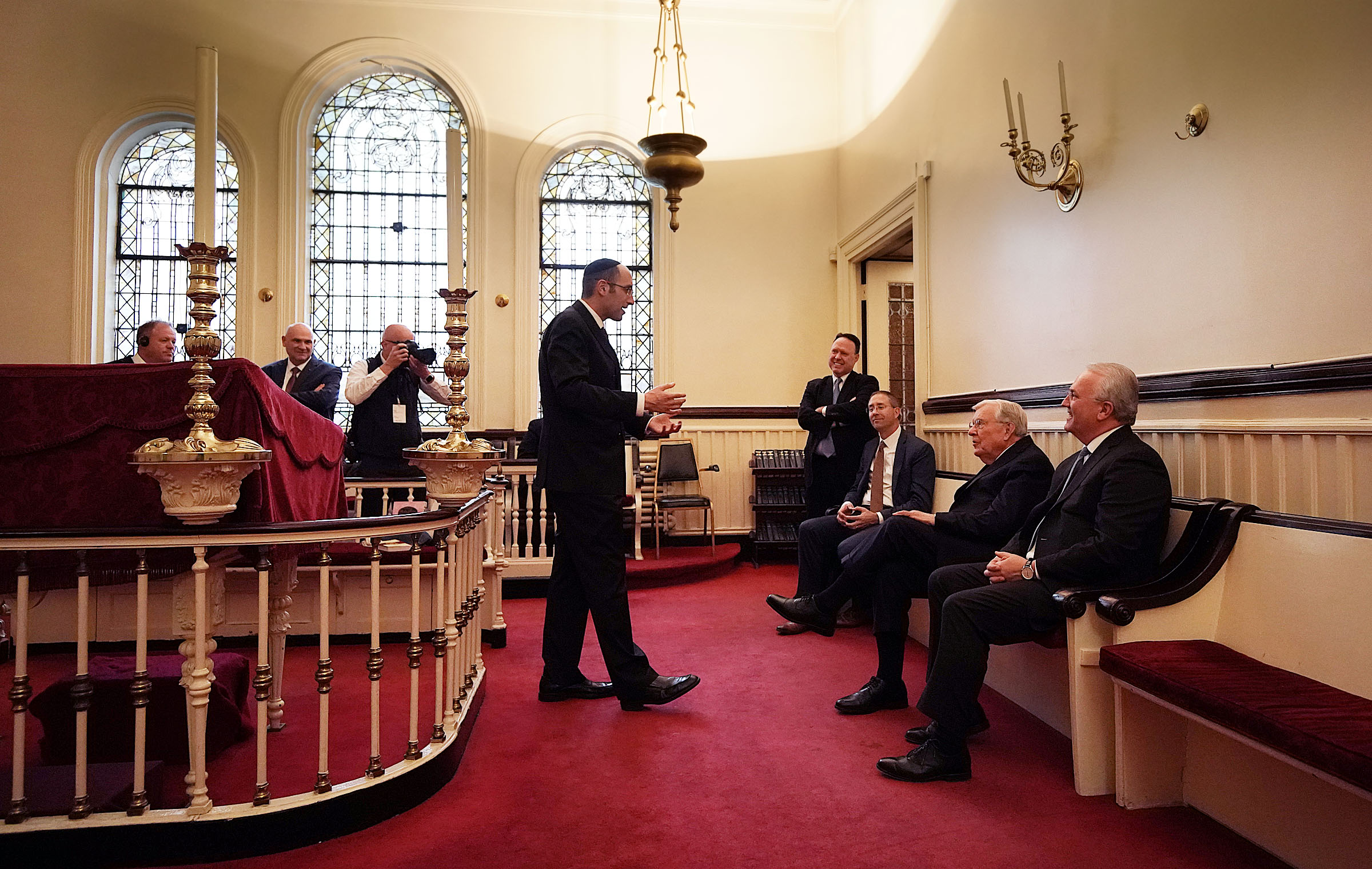 Rabbi Meir Y. Soloveichik, center, talks with President M. Russell Ballard, second from right, acting president of the Quorum of the Twelve Apostles, and Elder Jack N. Gerard, General Authority Seventy, right, during a tour of the Spanish and Portuguese Synagogue of the Congregation Shearith Israel in New York City on Friday, Nov. 15, 2019.