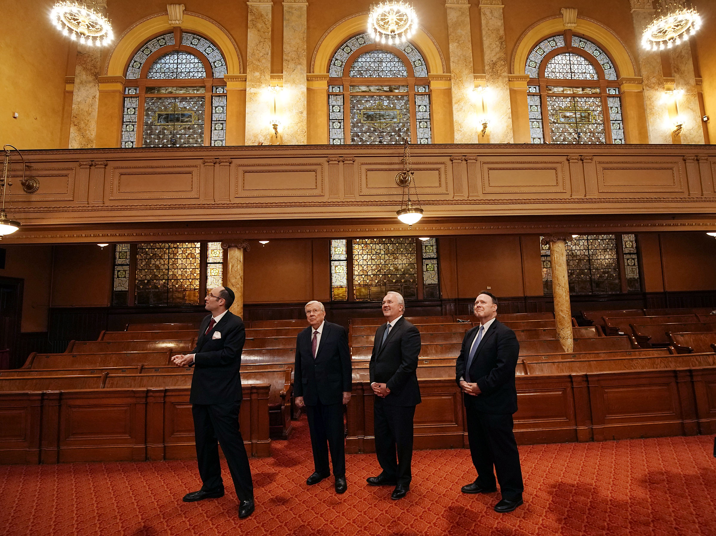 Rabbi Meir Y. Soloveichik, left, talks with President M. Russell Ballard, acting president of the Quorum of the Twelve Apostles, Elder Jack N. Gerard and Elder David L. Buckner of The Church of Jesus Christ of Latter-day Saints during a tour of the Spanish and Portuguese Synagogue of the Congregation Shearith Israel in New York City on Friday, Nov. 15, 2019.