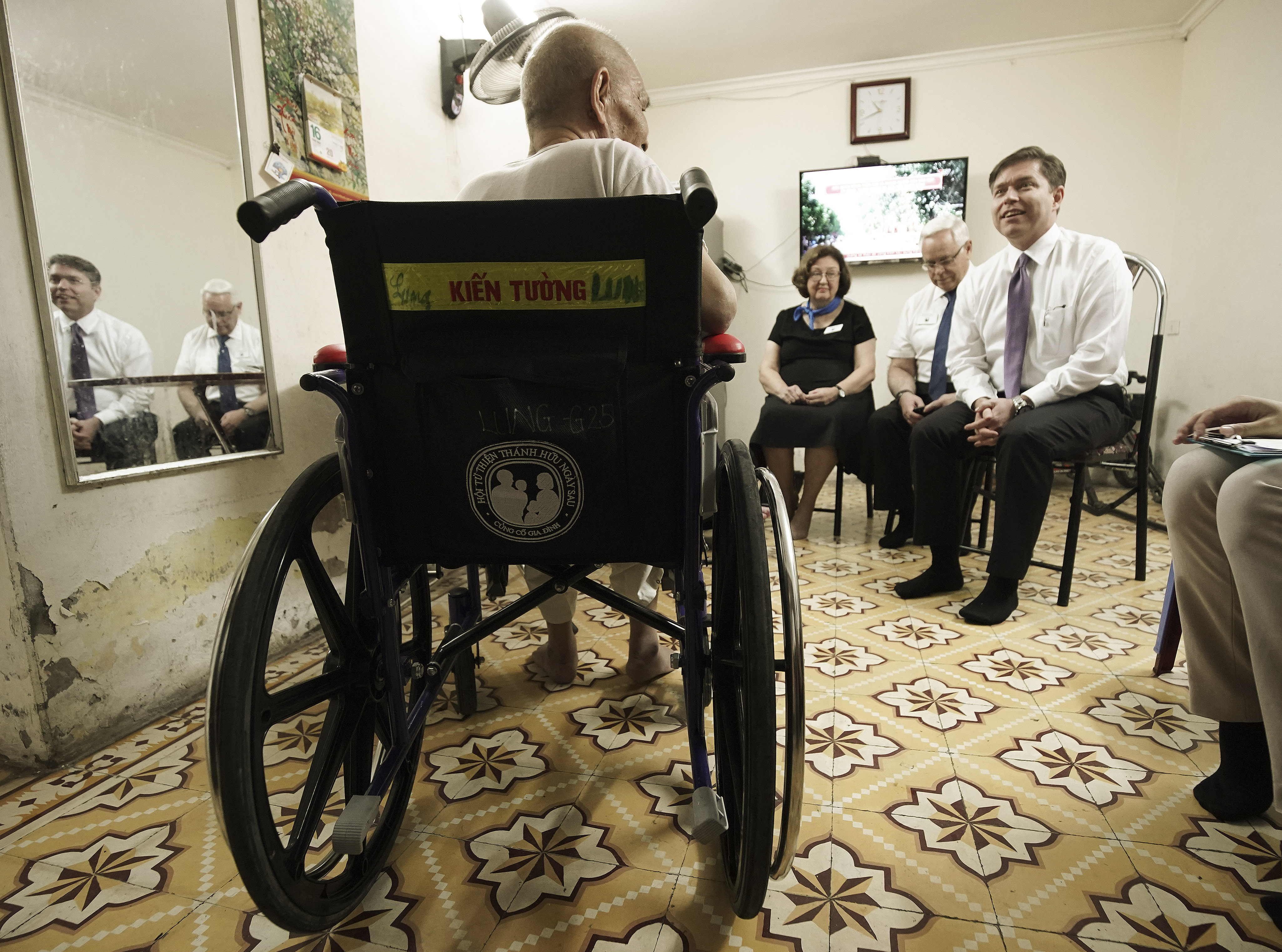 Lung Trong Le talks with Chad Furness, Asia Area Welfare and Self-Reliance Director, in his wheelchair given to him by Latter-day Saints Charities in Hanoi, Vietnam, on Saturday, Nov. 16, 2019.