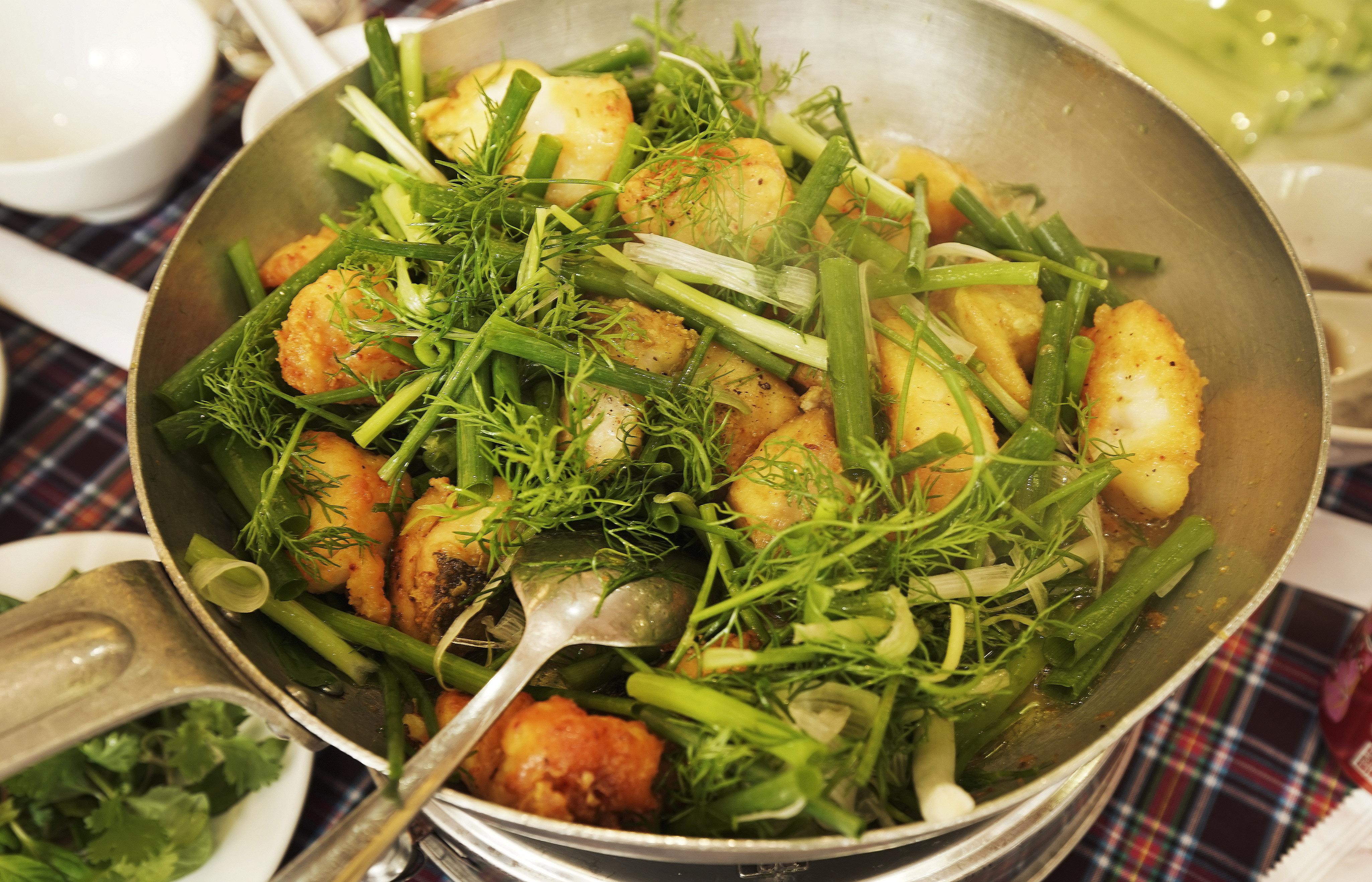 Catfish is prepared in a restaurant in Hanoi, Vietnam, on Saturday, Nov. 16, 2019.