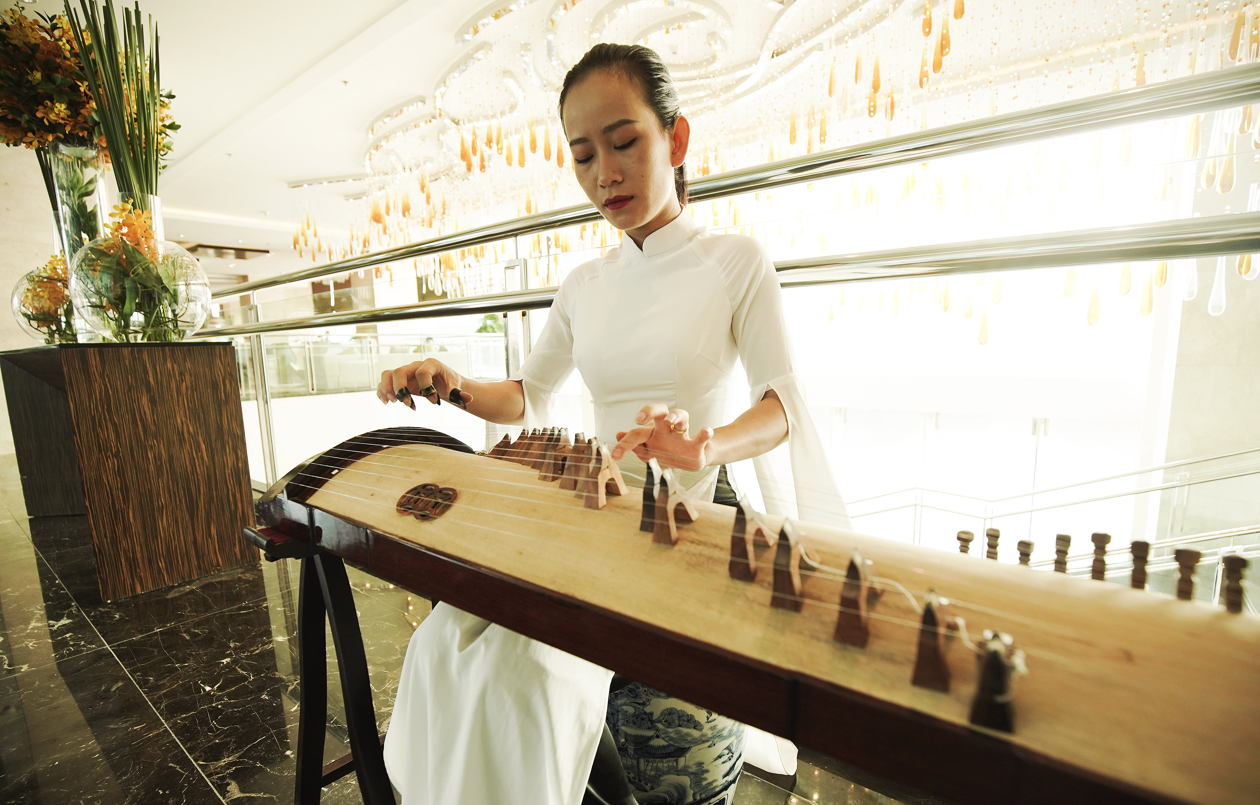 A woman plays the Zither in Hanoi, Vietnam, on Saturday, Nov. 16, 2019.