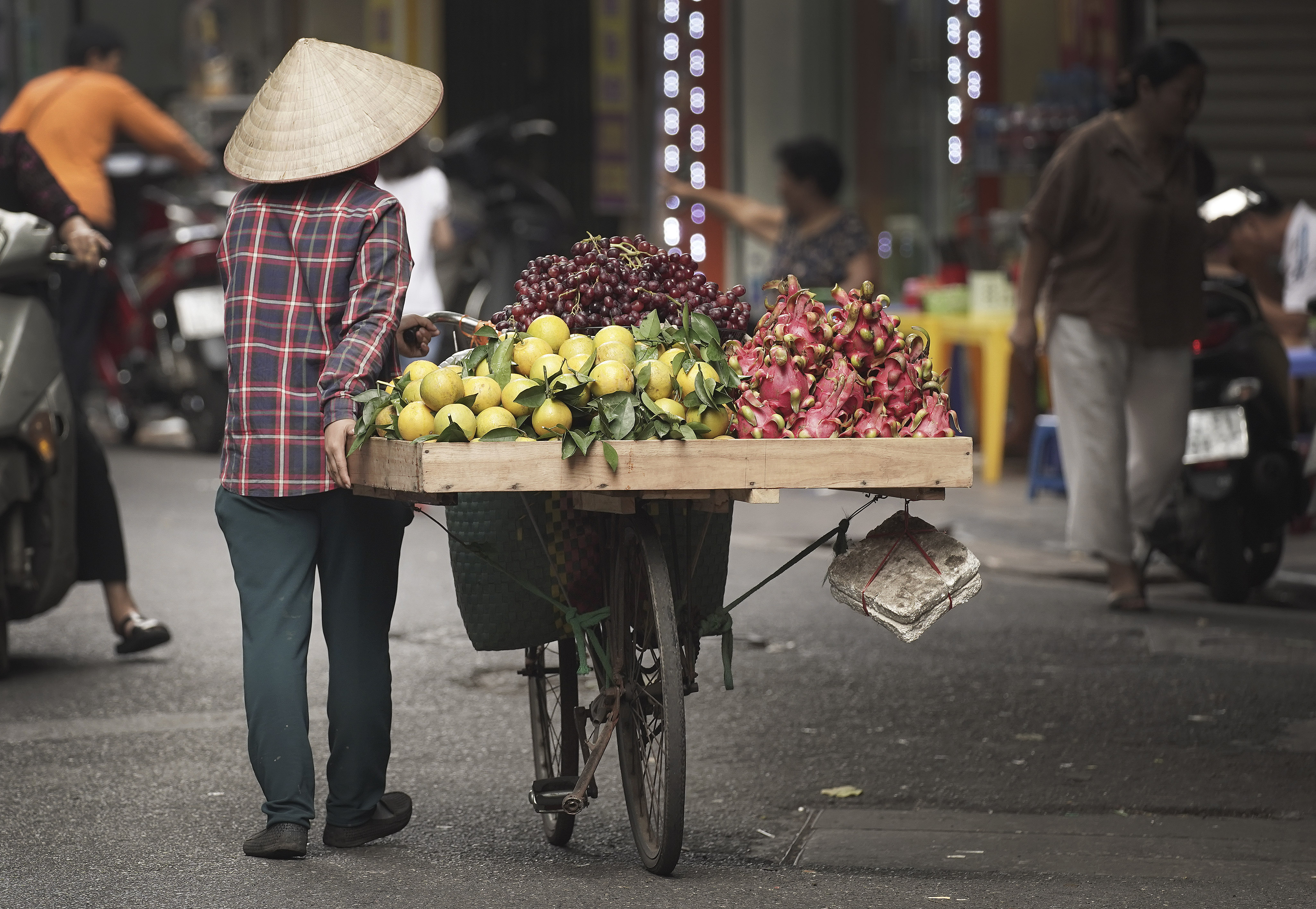 A woman sells produce in Hanoi, Vietnam, on Nov. 17, 2019.