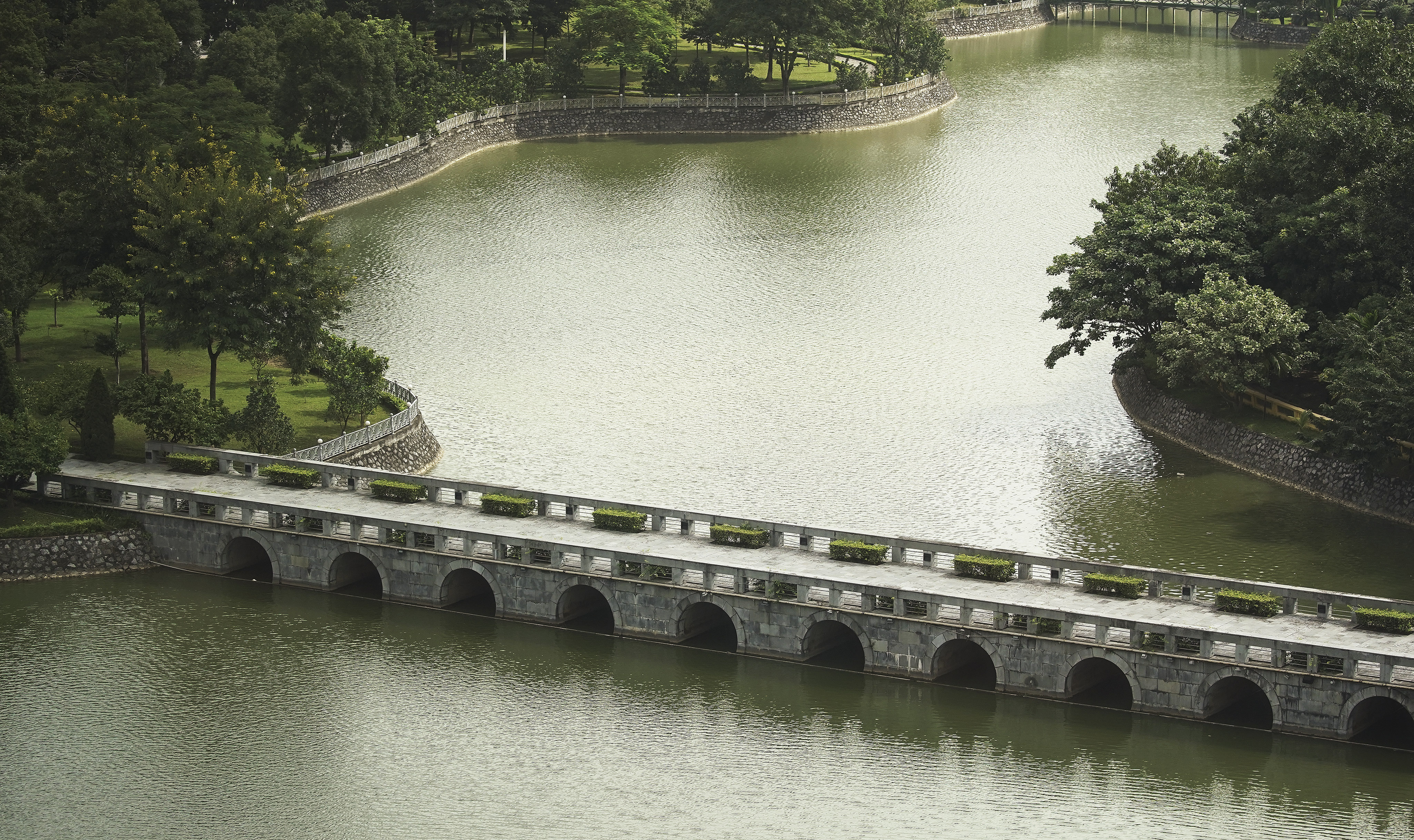 A bridge crosses a lake in Hanoi, Vietnam, on Sunday, Nov. 17, 2019.