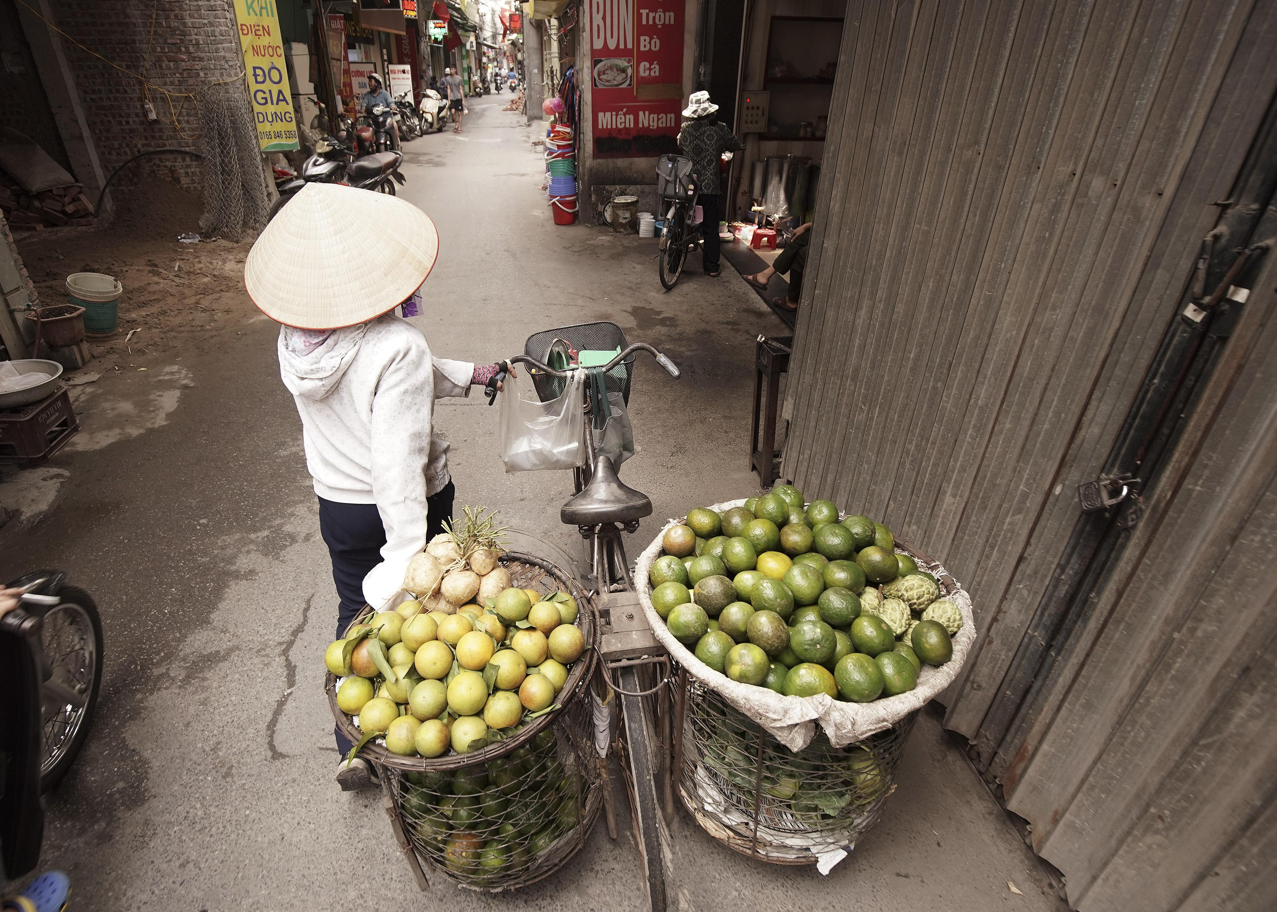 A woman sells produce in Hanoi, Vietnam, on Sunday, Nov. 17, 2019.