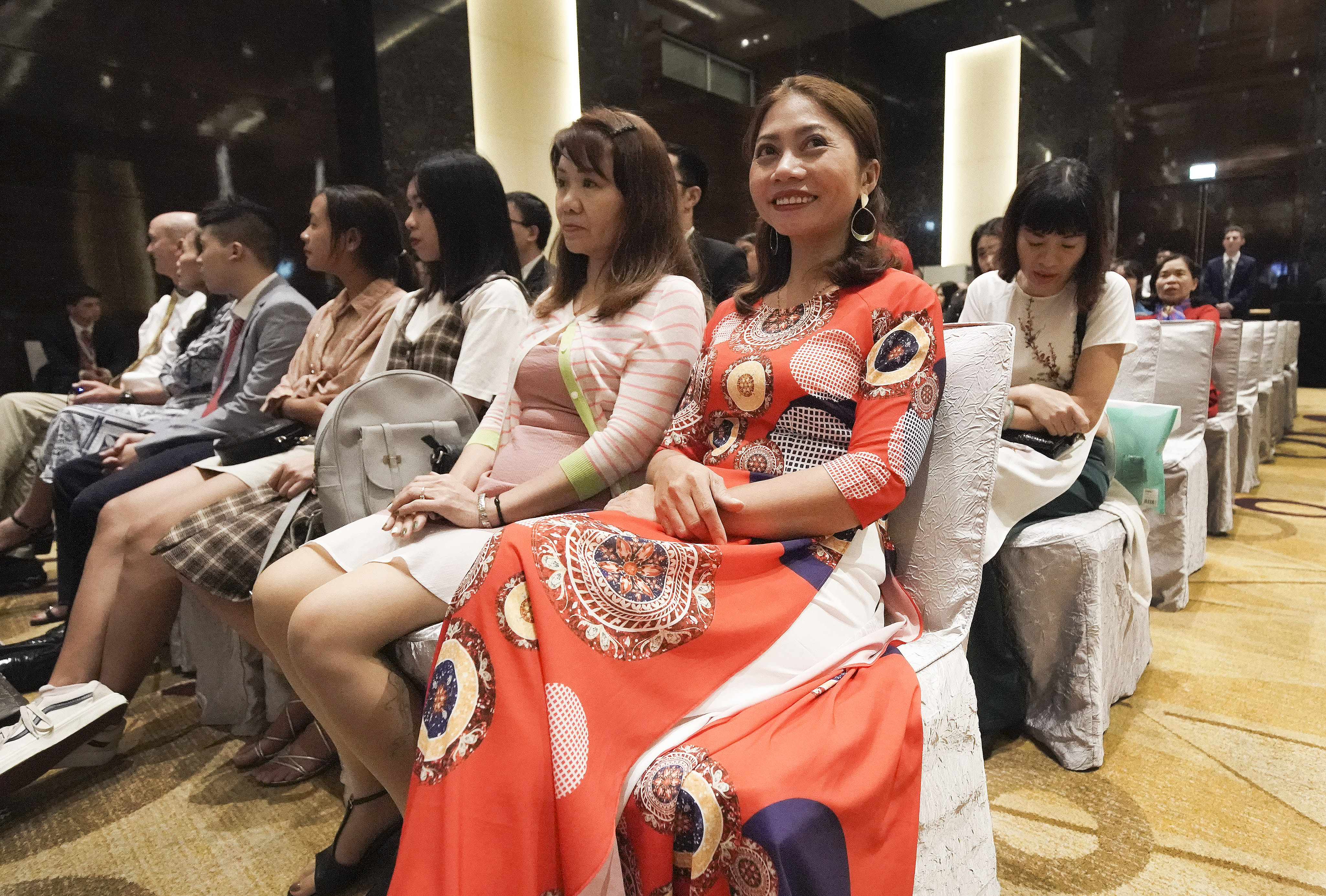 Nguyen Thi Hue waits to hear President Russell M. Nelson of The Church of Jesus Christ of Latter-day Saints, in Hanoi, Vietnam, on Sunday, Nov. 17, 2019.