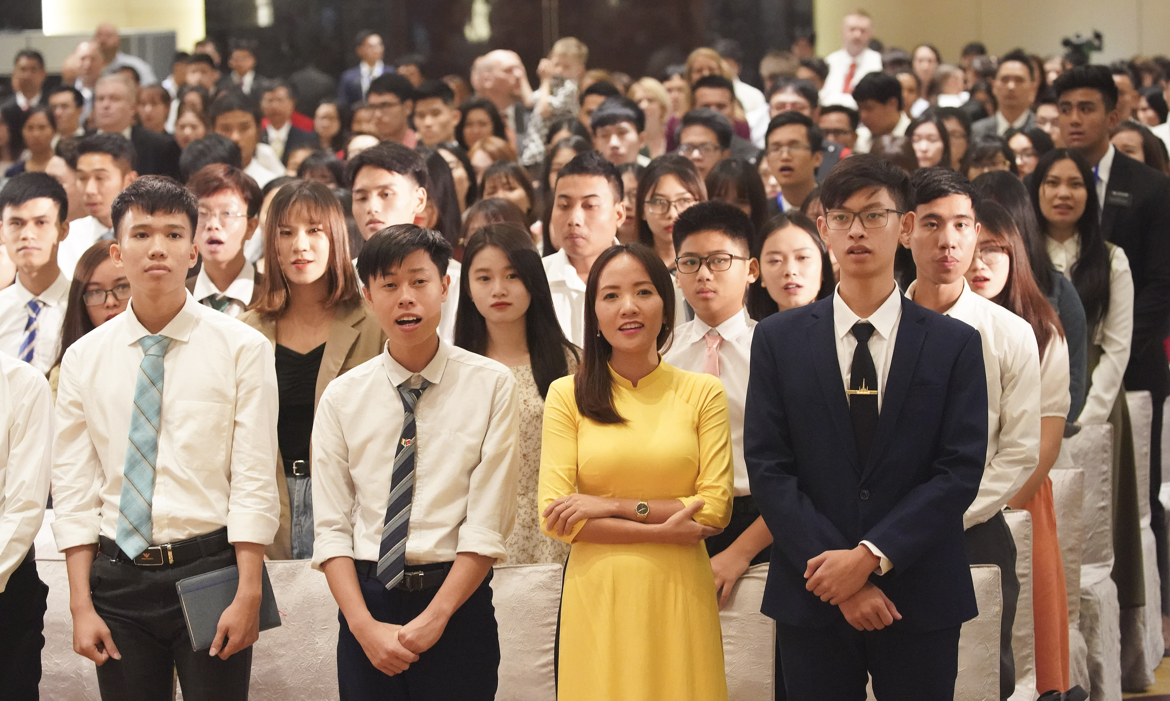 Attendees sing to President Russell M. Nelson of The Church of Jesus Christ of Latter-day Saints after a devotional in Hanoi, Vietnam, on Sunday, Nov. 17, 2019.