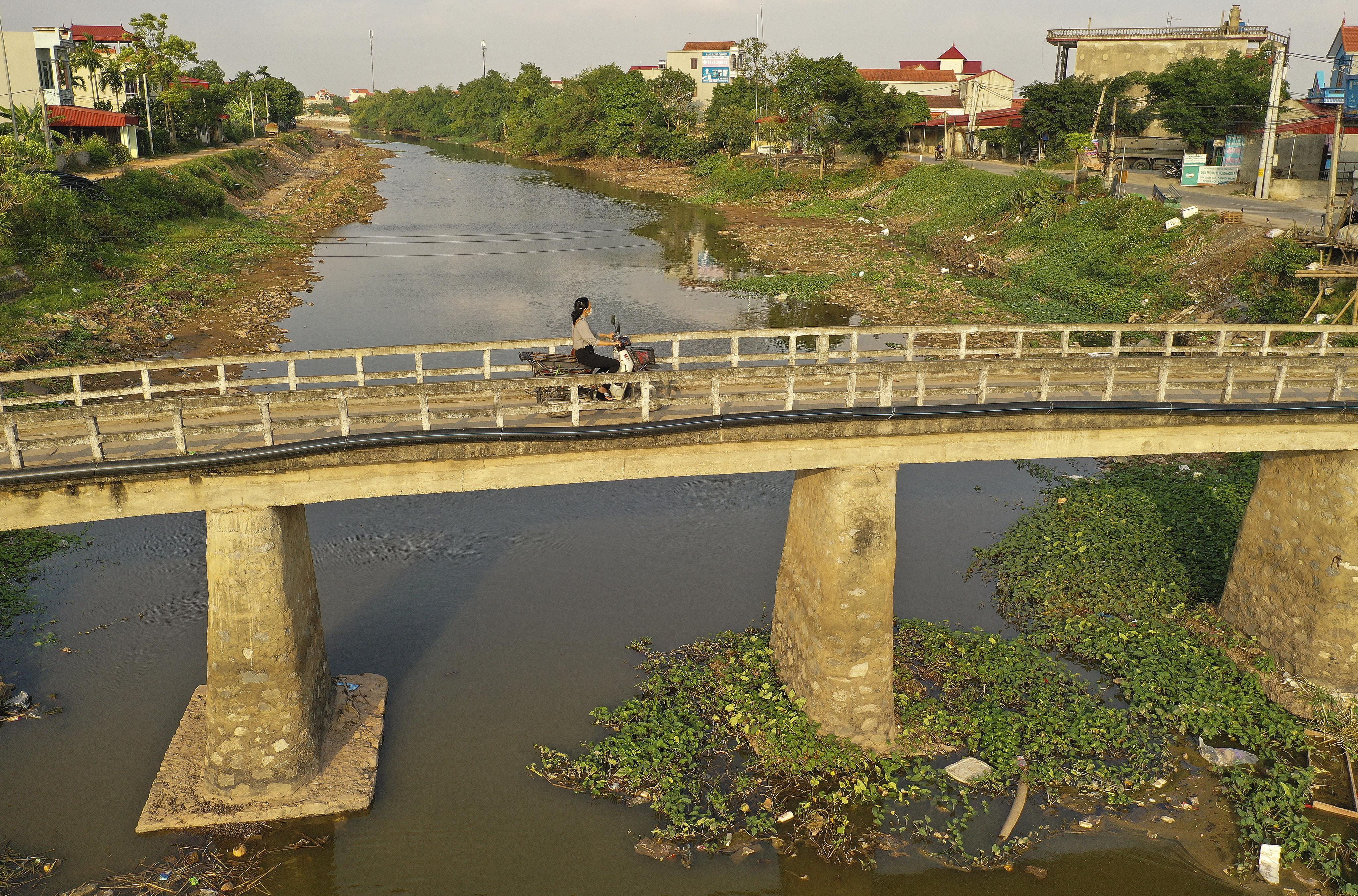 A motorist travels across a bridge in Hanoi, Vietnam on Saturday, Nov. 16, 2019.