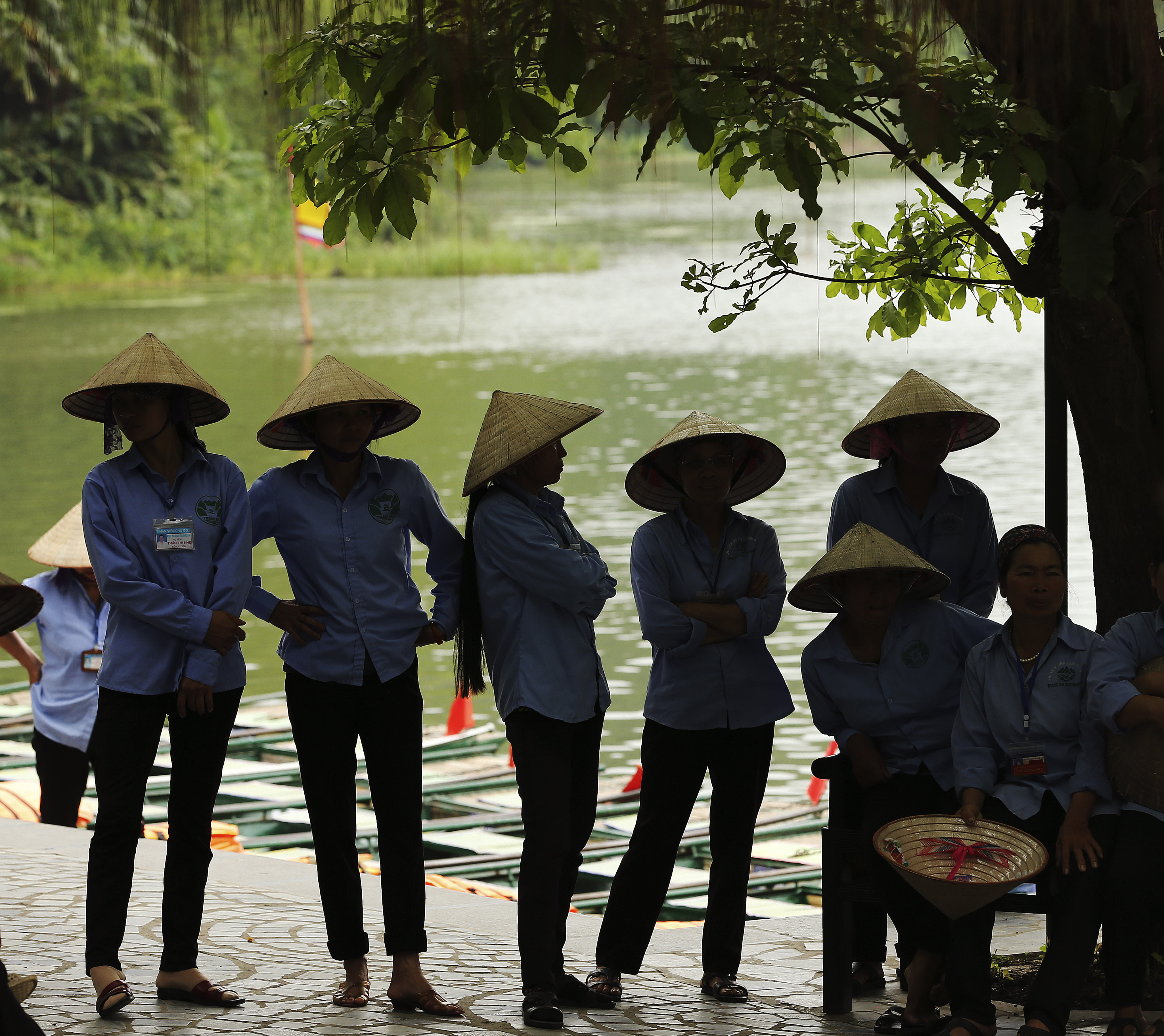 Tour guides wait for tourists in the aboriginal village in Trang An, Ninh Binh, Vietnam Apr 23, 2018.