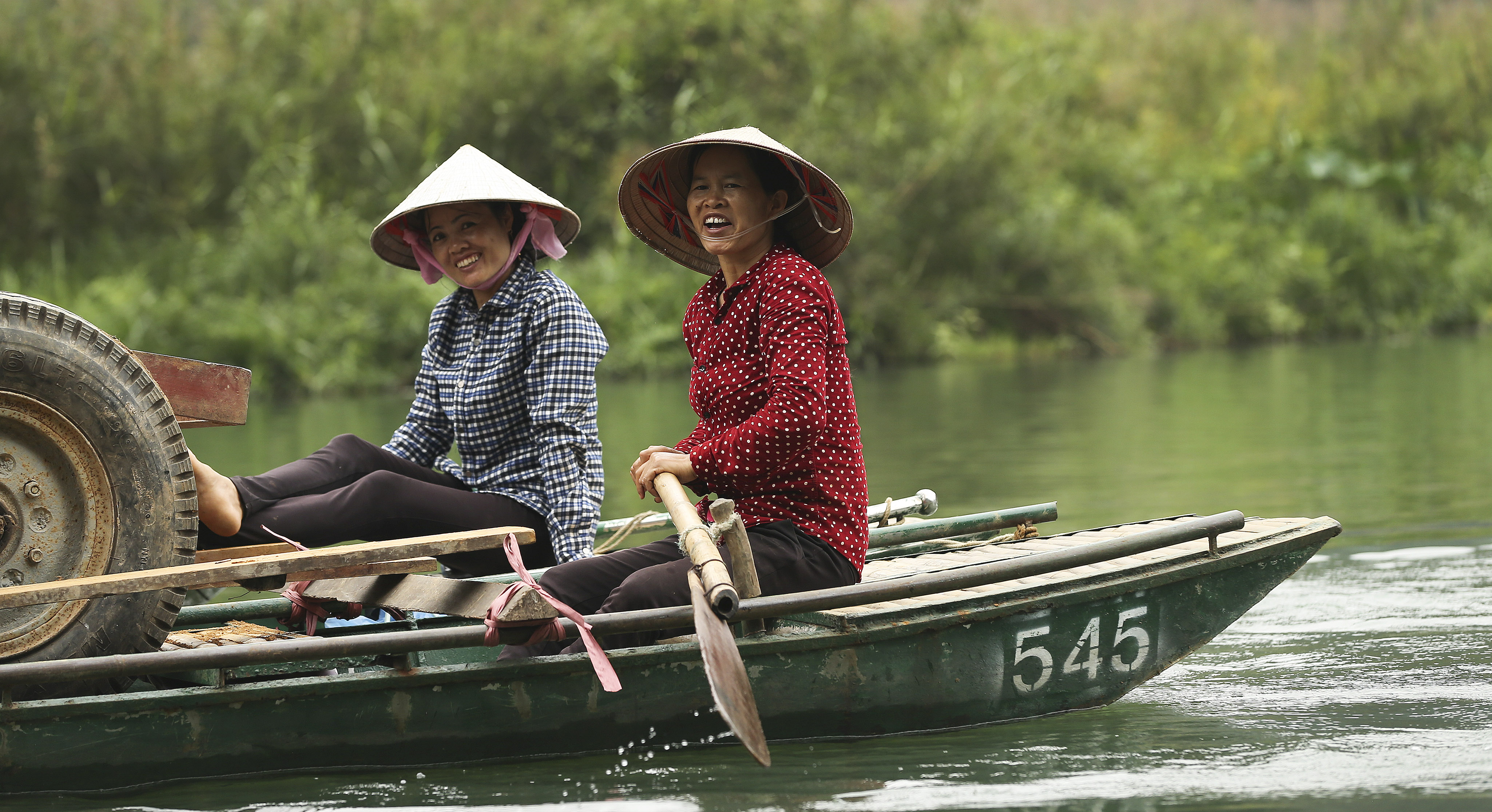 Women smile as they work near the aboriginal village in Trang An, Ninh Binh, Vietnam Apr 23, 2018.