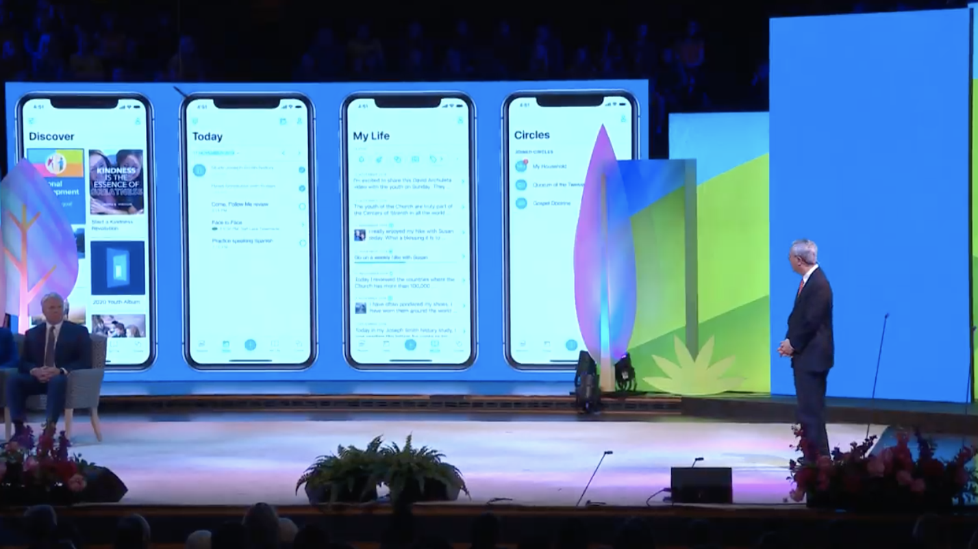 Elder Gerrit W. Gong explains the features of the Gospel Living app during a Face to Face event on the new Children and Youth program in the Tabernacle in Salt Lake City on Nov. 17.