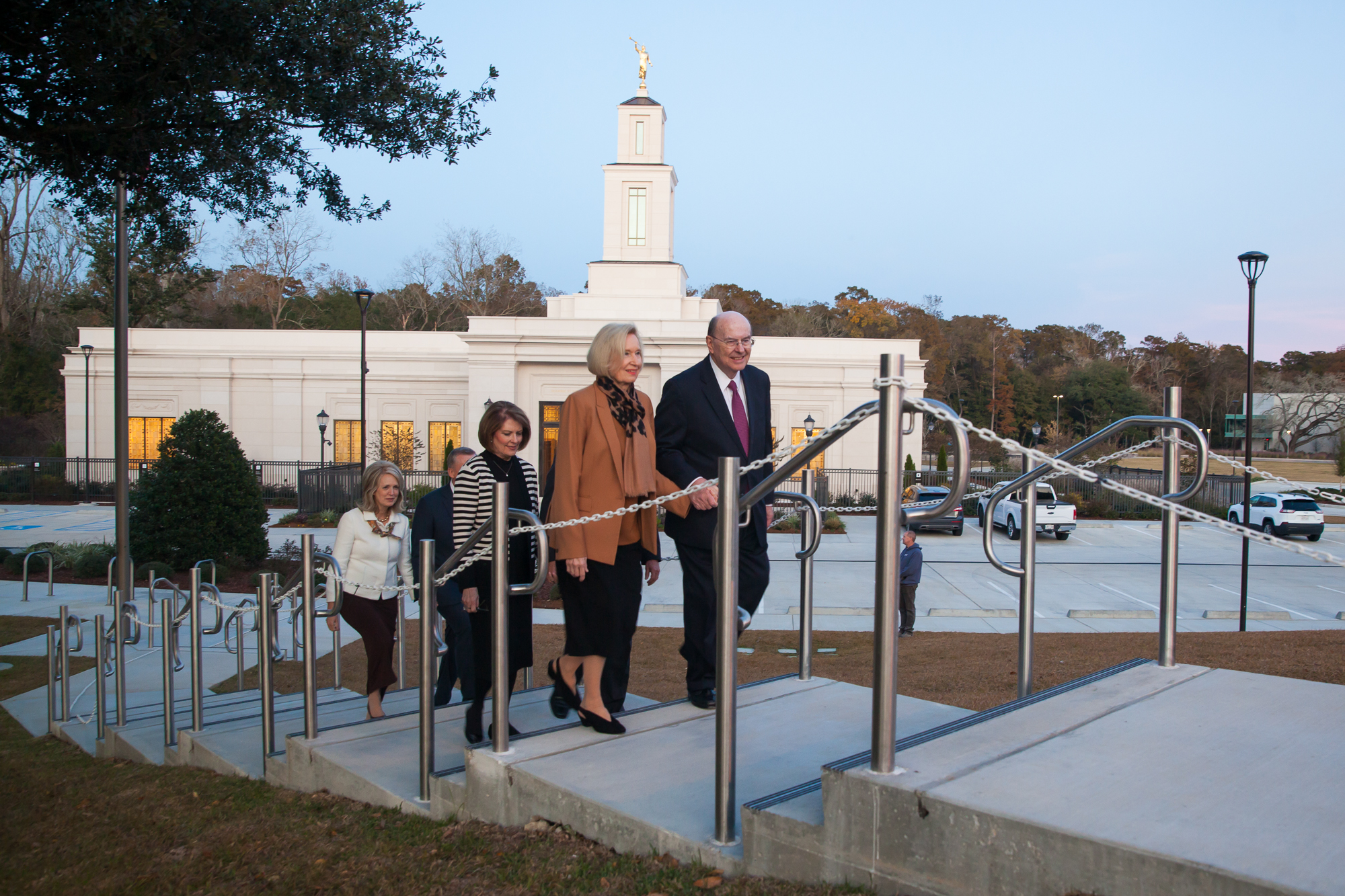 Elder Quentin L. Cook of the Quorum of the Twelve Apostles and his wife, Sister Mary Cook, walk up the path from the Baton Rouge Louisiana Temple to the adjacent stake center followed by Elder James B. Martino, General Authority Seventy and president of the North America Southeast Area, and his wife, Sister Jennie B. Martino and Elder Kevin R. Duncan, General Authority Seventy and executive director of the Temple Department, and his wife, Sister Nancy Duncan, on Saturday, Nov. 16, 2019.
