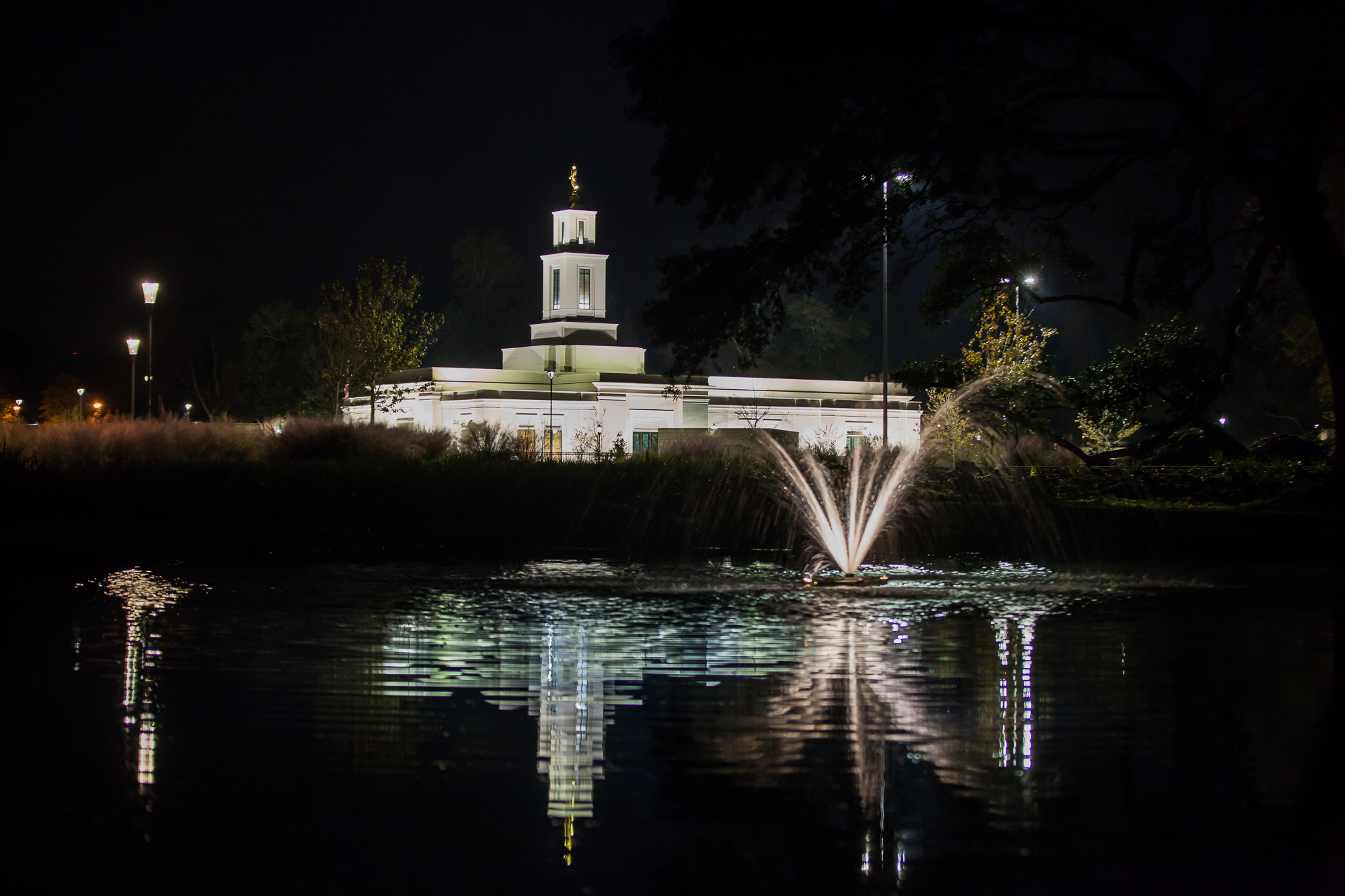 The Baton Rouge Louisiana Temple of The Church of Jesus Christ of Latter-day Saints is reflected in a nearby water feature on Saturday, Nov. 16, 2019, the evening before its rededication.