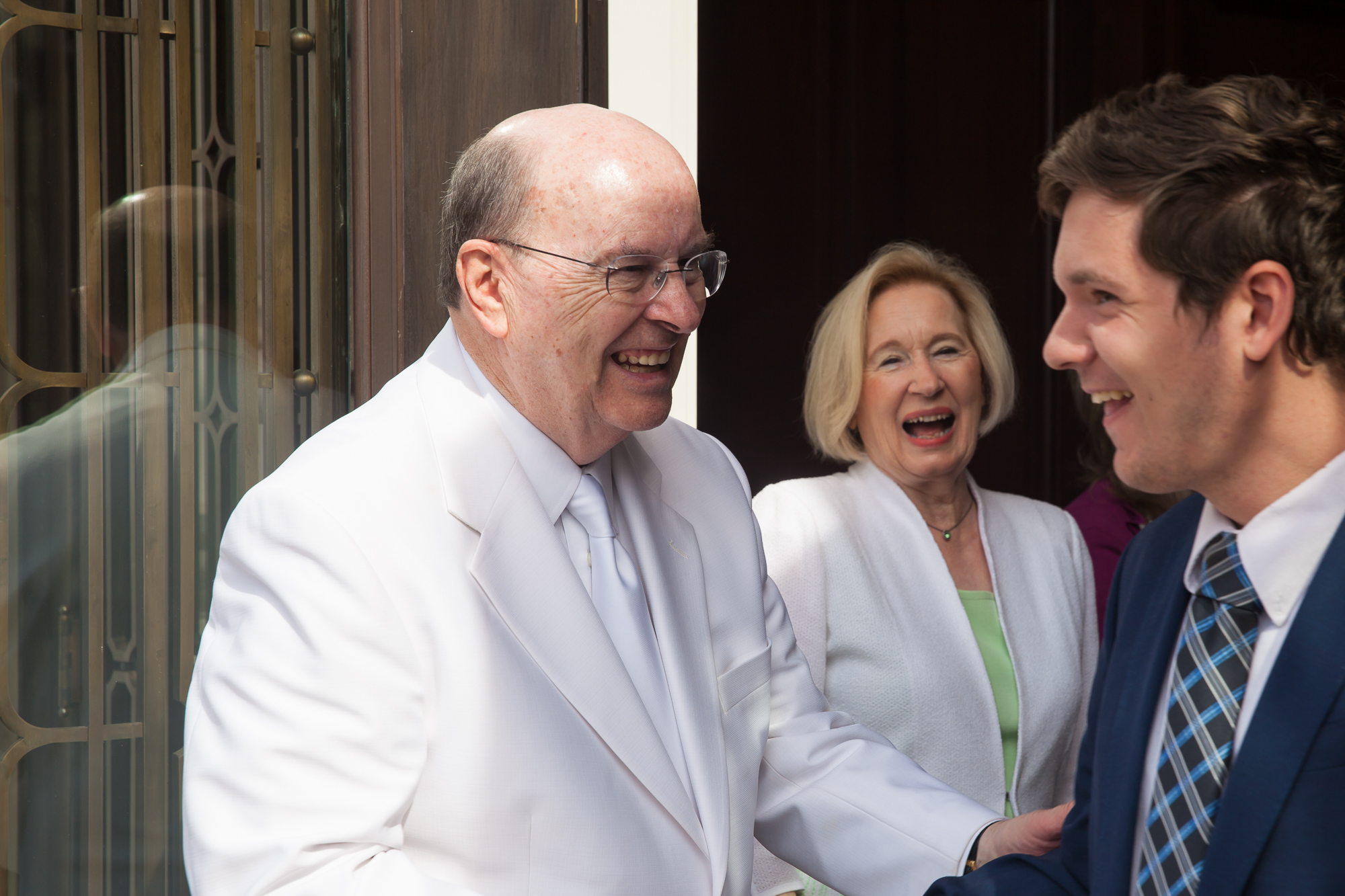 Elder Quentin L. Cook of the Quorum of the Twelve Apostles and his wife, Sister Mary Cook, shake hands with attendees of the Baton Rouge Louisiana Temple rededication as they exit the temple on Sunday, Nov. 17, 2019.