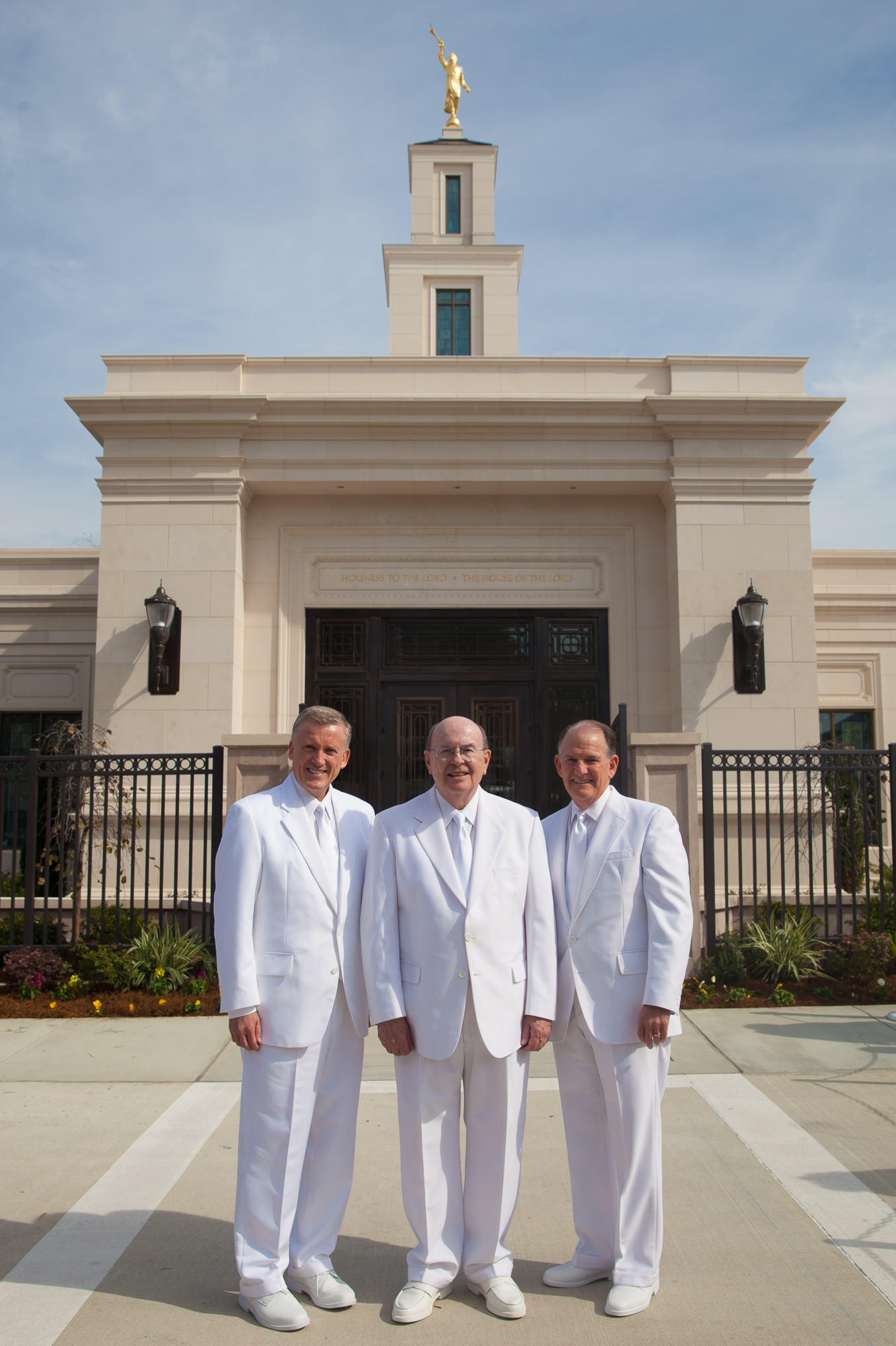 From left: Elder Kevin R. Duncan, Elder Quentin L. Cook and Elder James B. Martino pose for a photo outside of the Baton Rouge Louisiana Temple following its rededication on Sunday, Nov. 17, 2019.